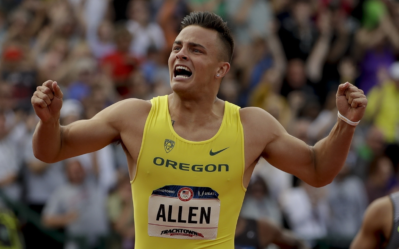 FILE - In this July 9, 2016 file photo, Devon Allen celebrates his win in the finals of the men's 110-meter hurdles at the U.S. Olympic Track and Field trials in Eugene Oregon. Allen, also a player for the Oregon Ducks football team, will make his Olympic debut on Monday, Aug. 15, 2016 at the opening heats of the 110-meter hurdles in Rio de Janeiro, Brazil. (AP Photo/Matt Slocum, File)