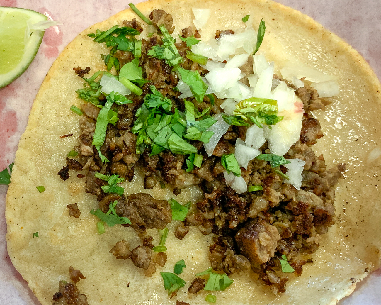 PLACE: Taqueria Cruz / ADDRESS: 518 W. Pike Street (Covington) / DESCRIPTION: This place is a hole in the wall restaurant if there ever was one, and I mean that as a huge compliment. Taqueria Cruz is tightly squeezed between a Sunoco and a laundromat on the outskirts of Covington (also, only a few blocks from Gutierrez, in the event you want to do a twofer) and features a good array of meats on its small menu. Cruz is similar to Gutierrez in that the taco is minimalist with just spices, cilantro, onions, and meat. But don't let that minimalism fool you: these tacos are incredible. One thing to keep in mind, they are cash only and there's an ATM at the Sunoco next door. / Image: Shawn Braley // Published: 5.28.19