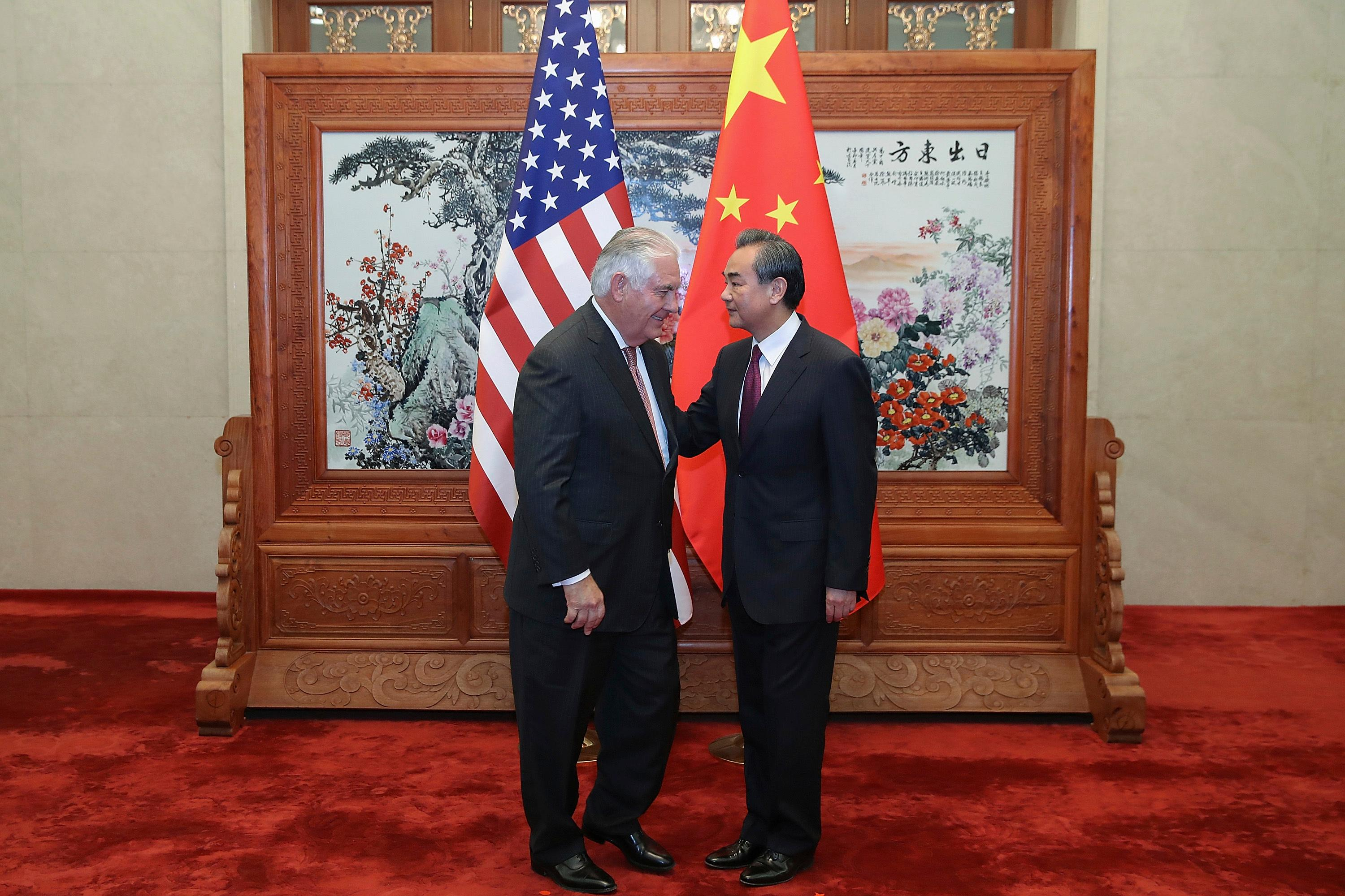 U.S. Secretary of State Rex Tillerson, left,  meets with Chinese Foreign Minister Wang Yi before their talks at the Great Hall of the People in Beijing Saturday, Sept. 30, 2017. (Lintao Zhang/Pool Photo via AP)
