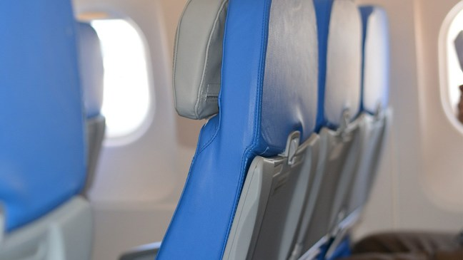 Want to avoid the flu while flying? Try a window seat... and don't get up!