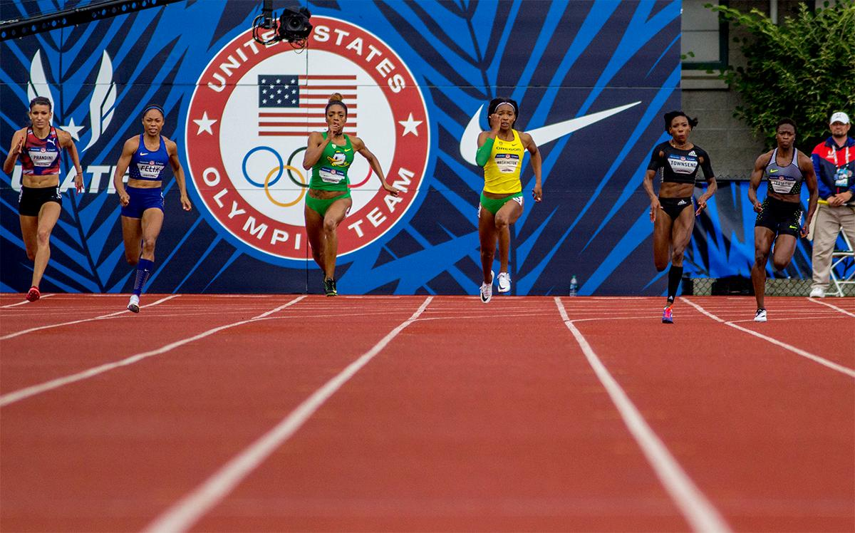 The athletes in the 200 meter final round the Bowman Curve to begin the sprint to the finish. The 200 meters was won by Adidas Tori Bowie in 22.25. Photo by August Frank, Oregon News Lab