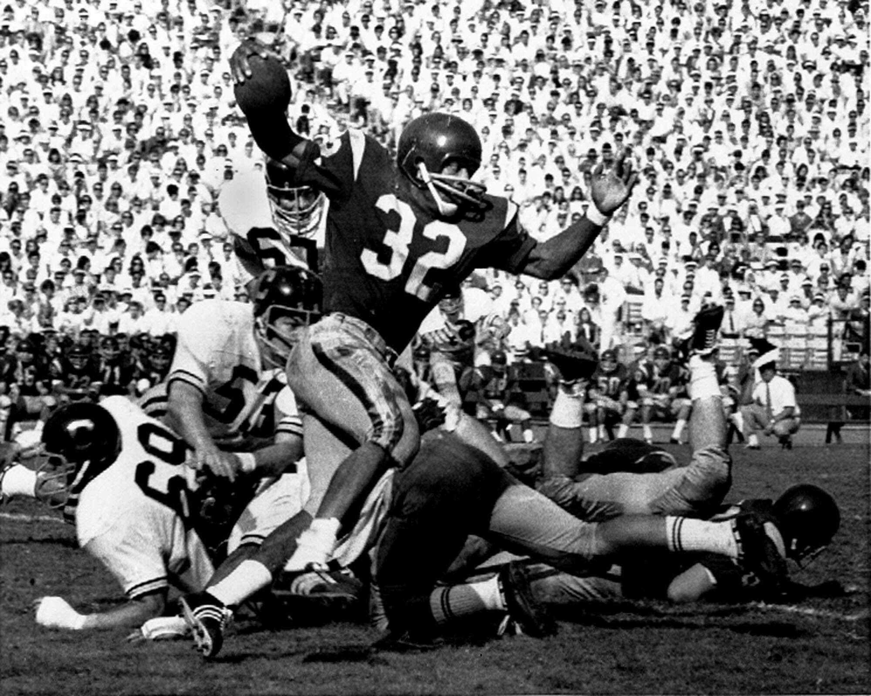 FILE - In this Nov. 9, 1968 file photo, Southern California's O.J. Simpson (32) runs against California during a college football game in Los Angeles. Simpson won the Heisman Trophy at Southern California in 1968. Simpson will have a lot going for him when he asks state parole board members Thursday, July 20, 2017, to release him after serving more than eight years for an ill-fated bid to retrieve sports memorabilia. A Nevada prison official said early Sunday, Oct. 1, 2017, O.J. Simpson, the former football legend and Hollywood star, has been released from a Nevada prison in Lovelock after serving nine years for armed robbery. (AP Photo/HF, File)