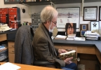 Dr. Gene Kritsky Reviewing Books In His Office.jpg