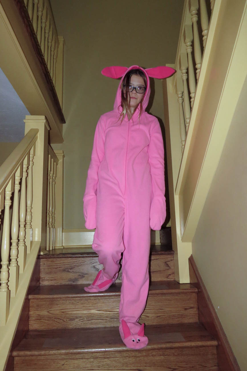 "Try on Ralphie's precious gift from Aunt Clara—described by some as a ""deranged Easter bunny"" or ""pink nightmare."" / Image: Chez Chesak // Published: 12.8.18"