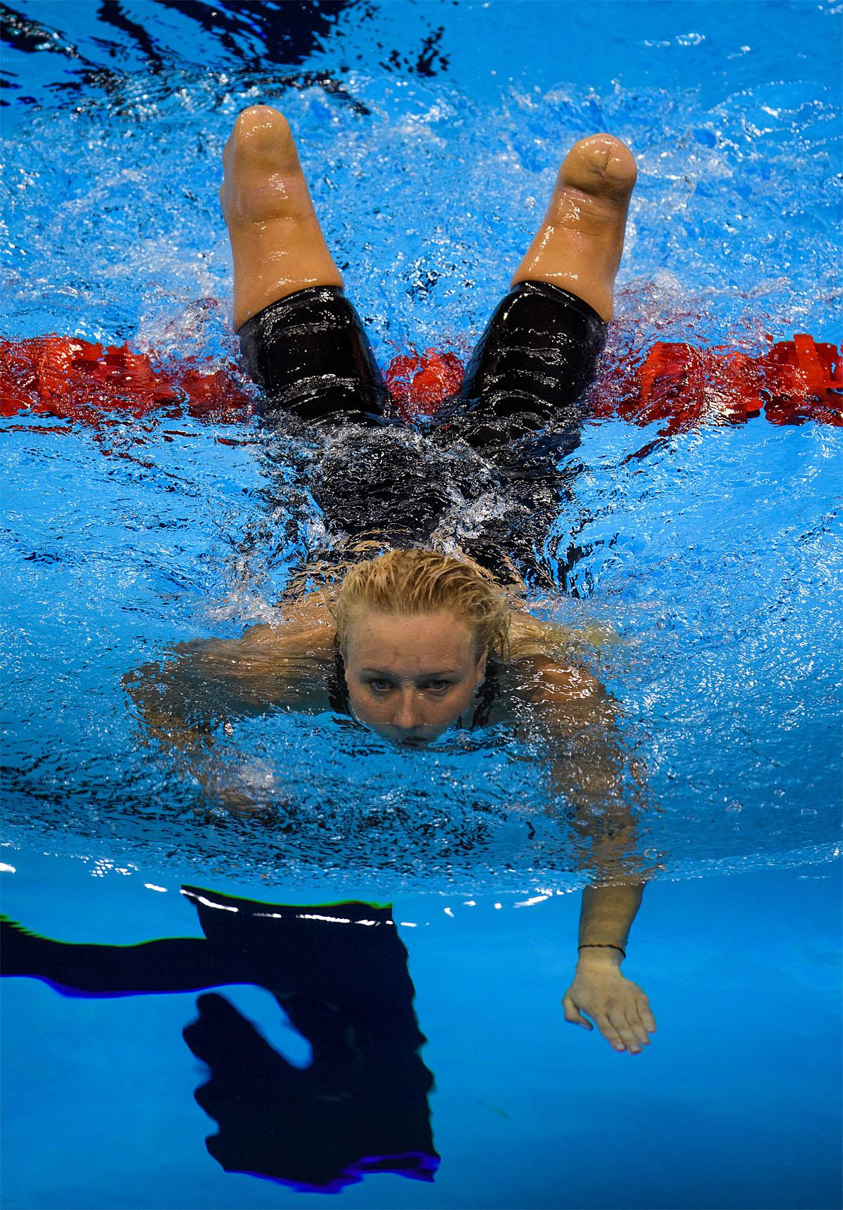 In this photo provided by the IOC, Jessica Long of the United States, swims in the pool after competing in the women's 100-meter butterfly - S8 heat 1 swimming event at the Olympic Aquatics Stadium during the Paralympic Games, in Rio de Janeiro, Brazil, Friday, Sept. 9, 2016. (Bob Martin/OIS,IOC via AP)
