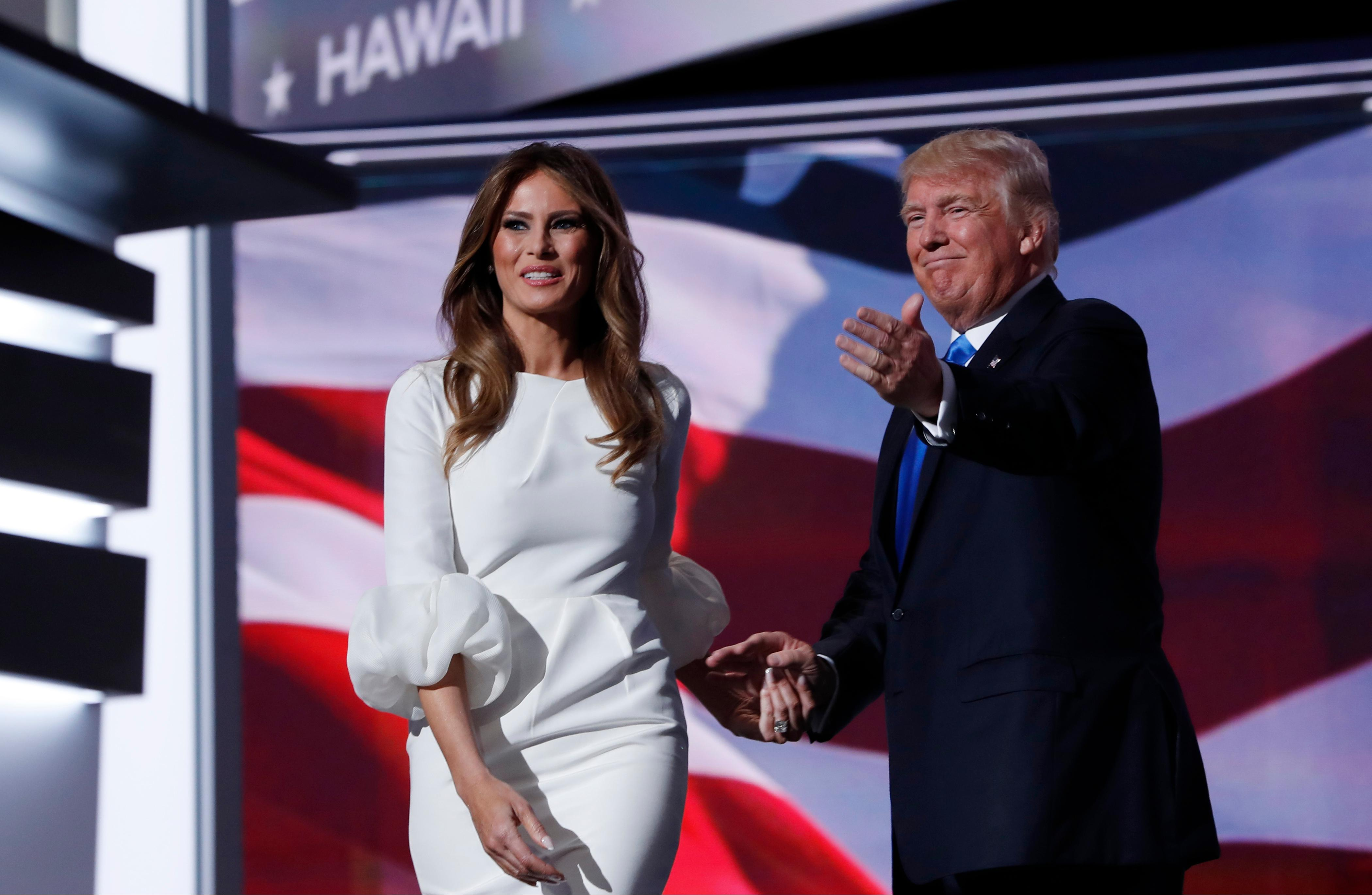 Melania Trump, wife of Republican Presidential Candidate Donald Trump walks to the stage as Donald Trump introduces her during the opening day of the Republican National Convention in Cleveland, Monday, July 18, 2016. (AP Photo/Carolyn Kaster)
