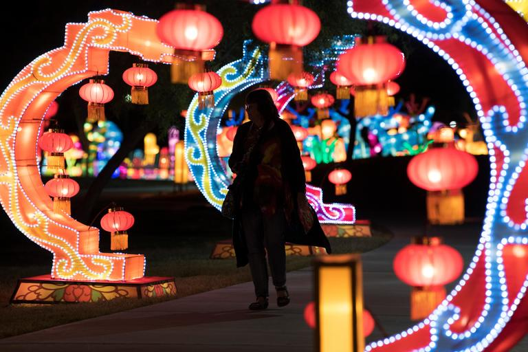 A woman walks between arches on the opening night of the China Lights lantern festival Friday, January 19, 2018, at Craig Ranch Regional Park in North Las Vegas. The festival, which features nearly 50 silk and LED light displays comprised of over 1000 elements, runs through February 25th. CREDIT: Sam Morris/Las Vegas News Bureau