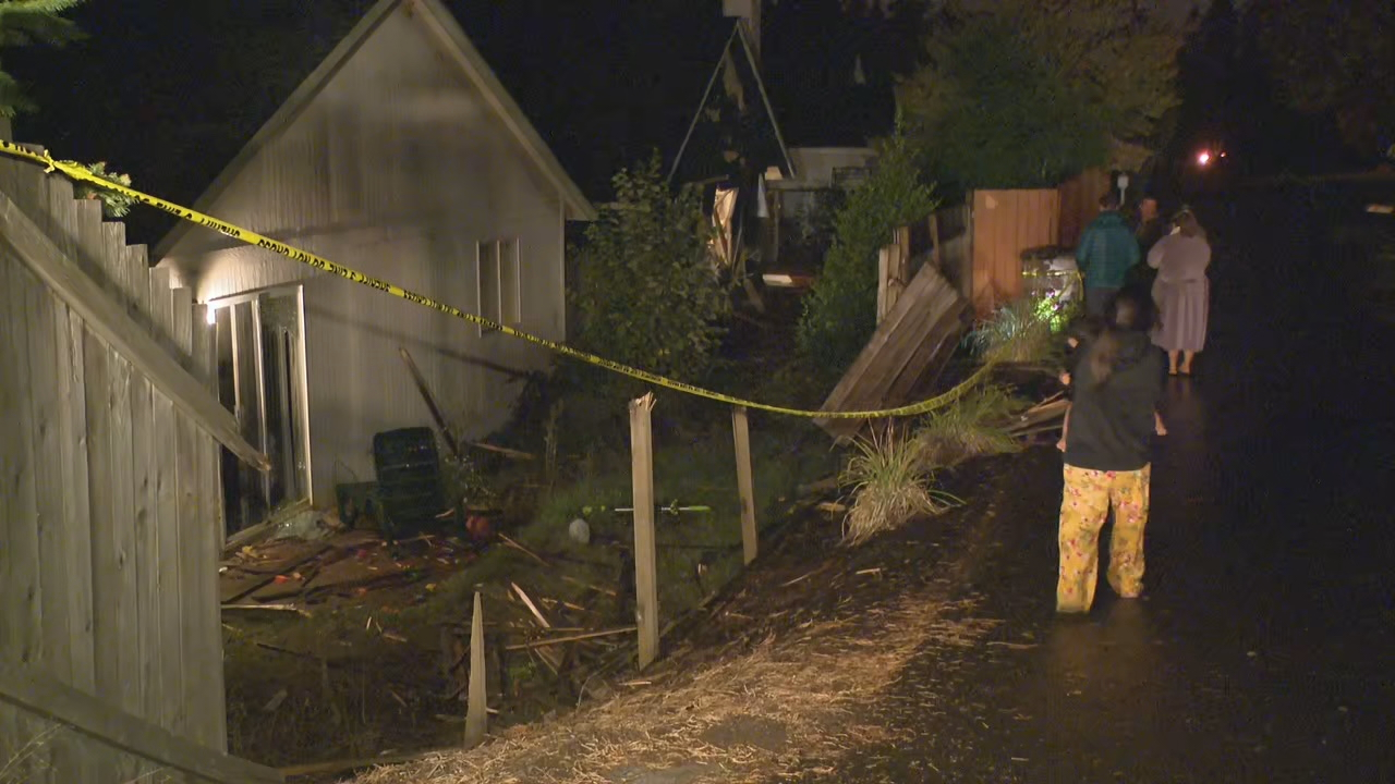A driver hit a car, crashed through three fences, and smashed into a house in Tigard on Sept. 13, 2019. KATU photo<p></p>
