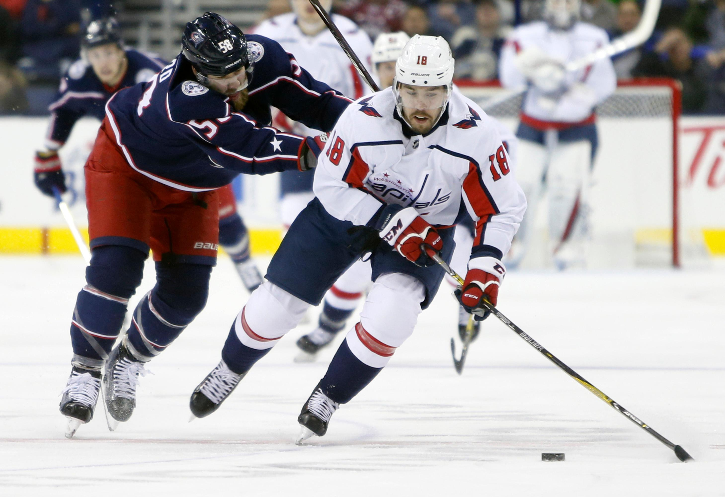 Washington Capitals' Chandler Stephenson, right, carries the puck up ice as Columbus Blue Jackets' David Savard defends during the first period of an NHL hockey game Tuesday, Feb. 6, 2018, in Columbus, Ohio. (AP Photo/Jay LaPrete)