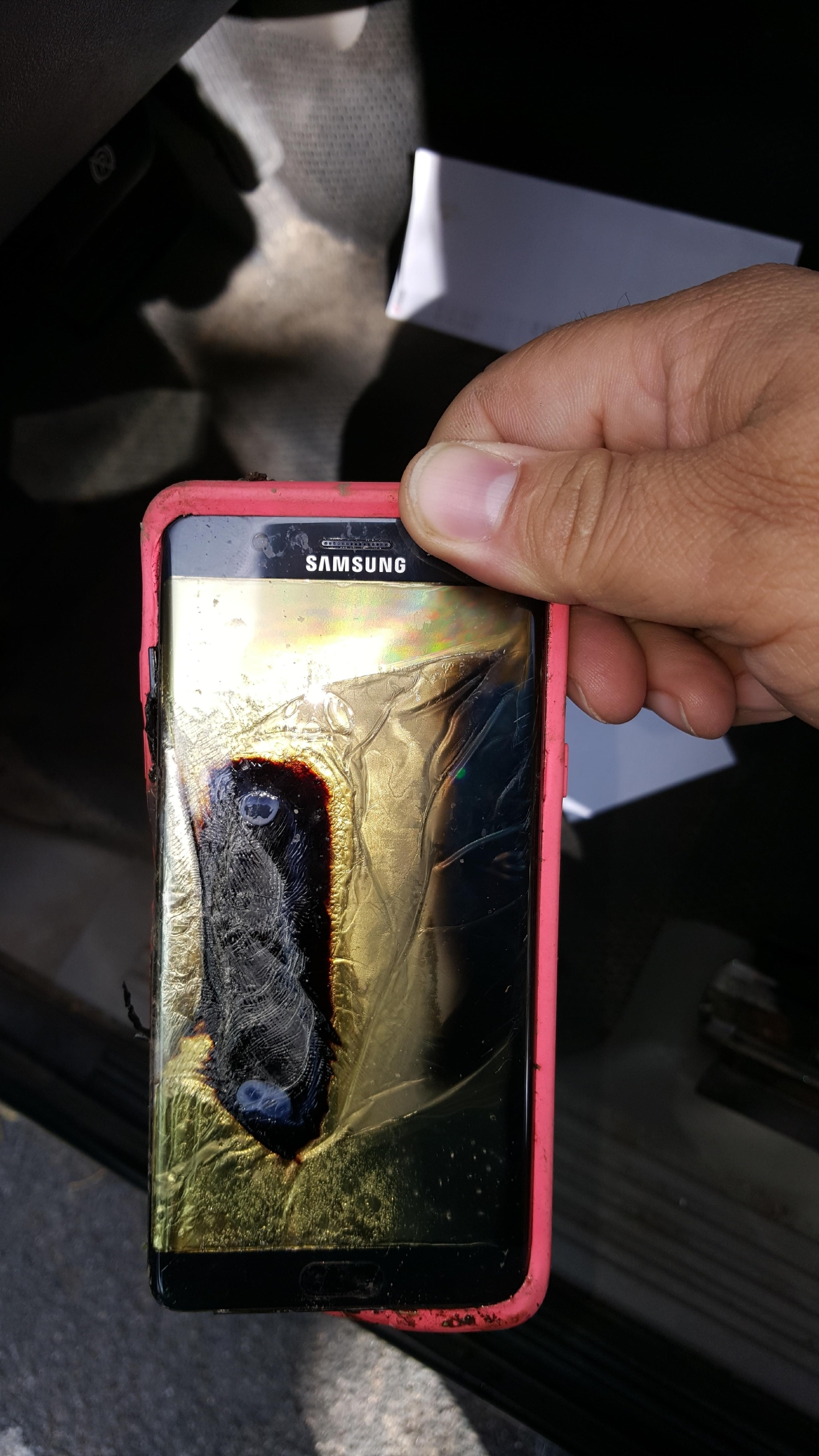 This Friday, Oct. 7, 2016, photo provided by Andrew Zuis, of Farmington, Minn., shows the replacement Samsung Galaxy Note 7 phone belonging to his 13-year-old daughter Abby, that melted in her hand earlier in the day. (Andrew Zuis via AP)
