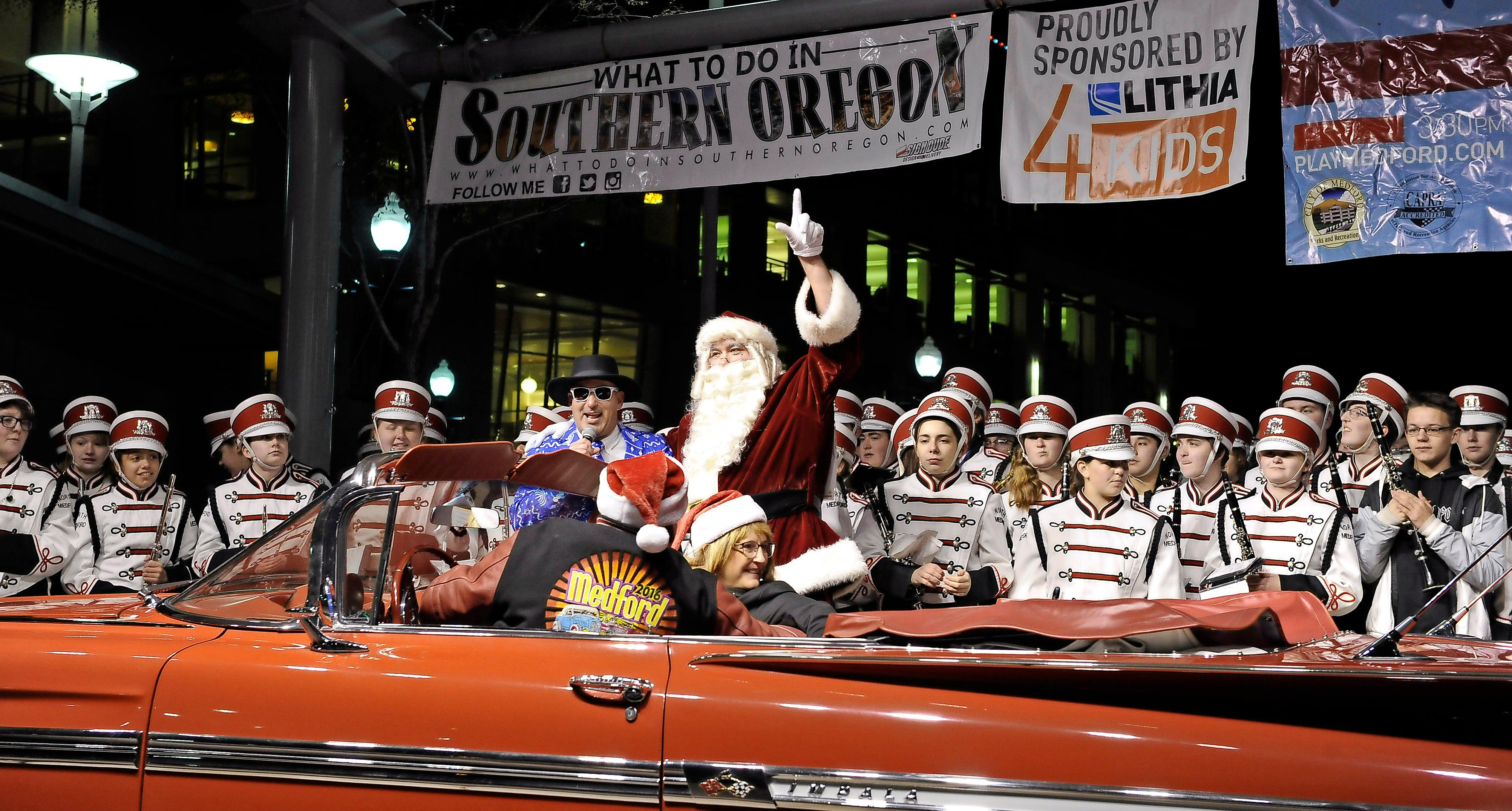 Andy Atkinson / Mail TribuneSanta pulled up onto stage in front of North Medford Marching Band at Pear Blossom Park Saturday evening.