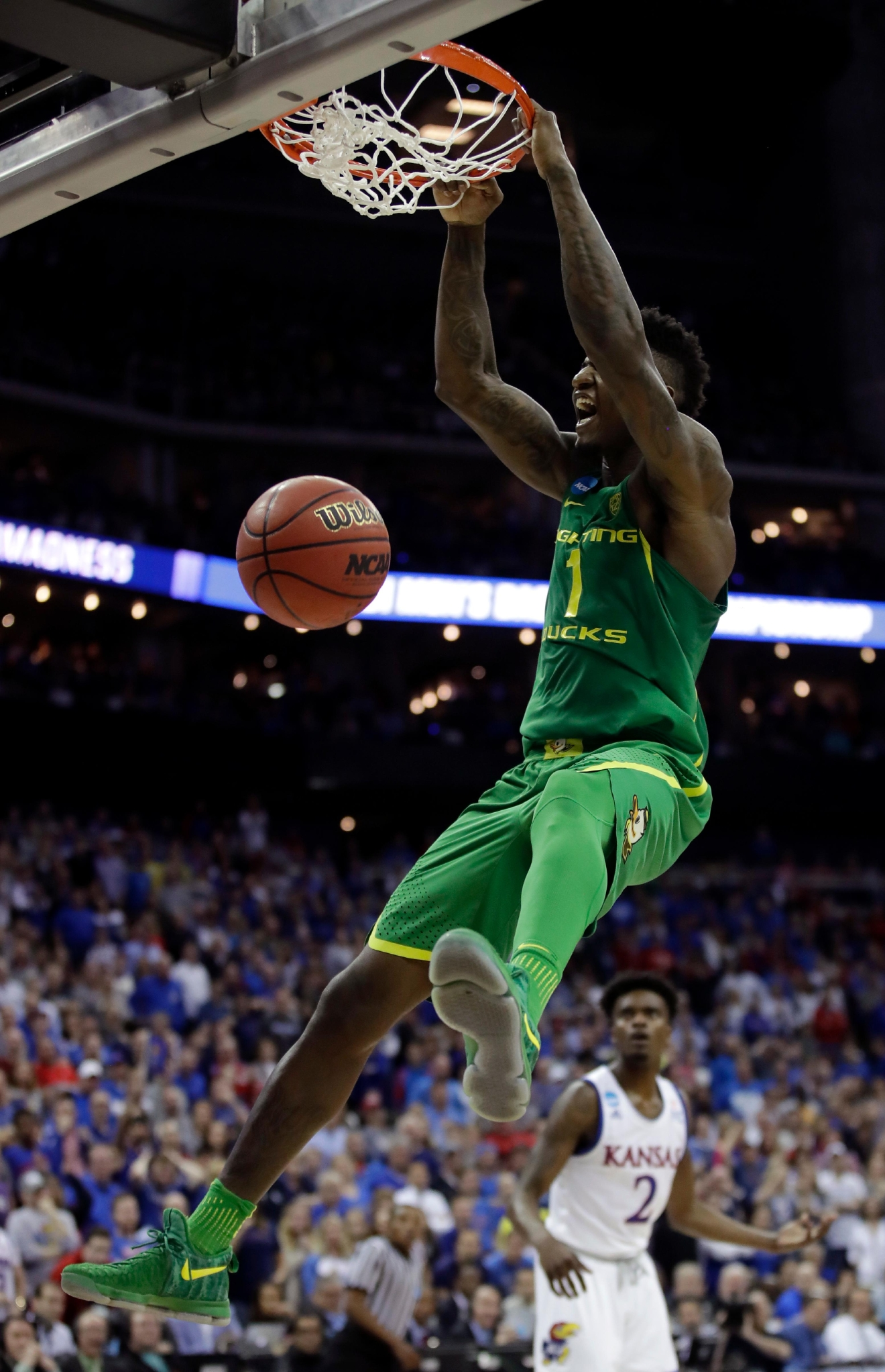 Oregon forward Jordan Bell dunks as Kansas guard Lagerald Vick (2) watches during the second half of the Midwest Regional final of the NCAA men's college basketball tournament, Saturday, March 25, 2017, in Kansas City, Mo. (AP Photo/Charlie Riedel)