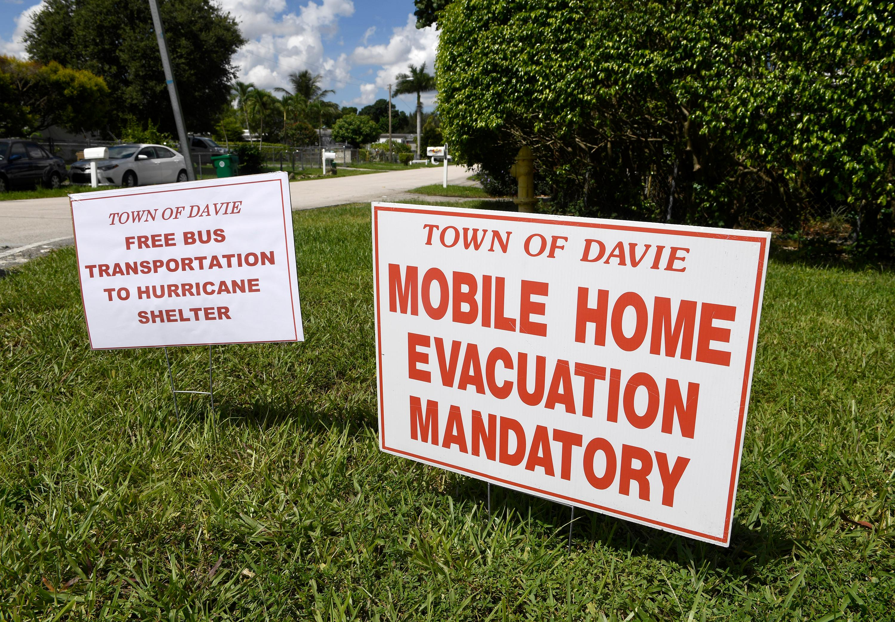 Two signs are displayed outside the SAGA Estates Mobile Home Park in Davie, Fla., Thursday, Sept. 7, 2017, telling residents that there is a mandatory evacuation for all mobile home residents in effect  as Hurricane Irma threatens South Florida. (Taimy Alvarez/South Florida Sun-Sentinel via AP)