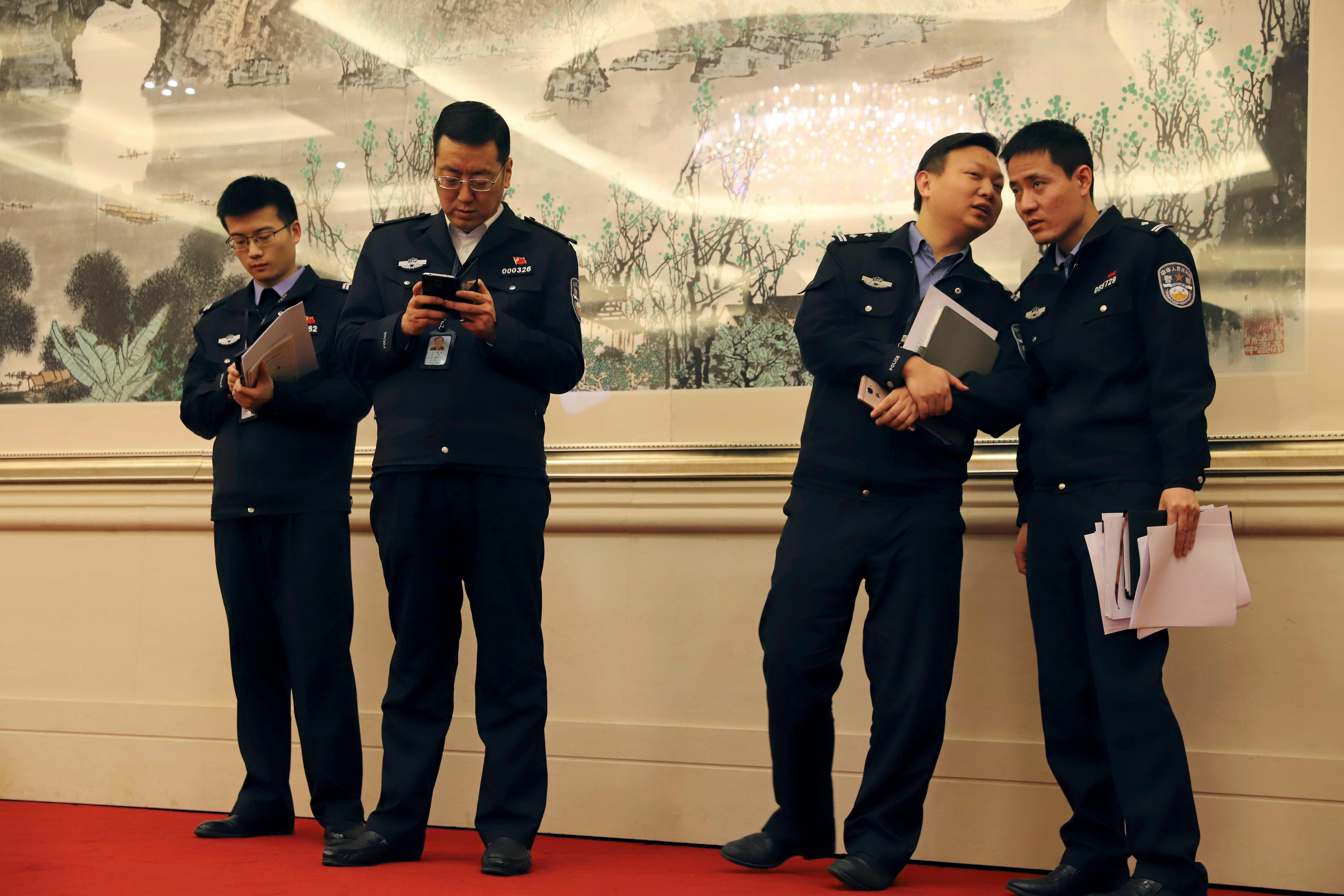 Chinese police gather during a press conference on held in Beijing, China, Thursday, Dec. 28, 2017. Yu Haibin of the China National Narcotics Control Commissionsaid Thursday there was little evidence showing China was the source of much of the chemicals used in the production of the powerful opioid fentanyl. (AP Photo/Ng Han Guan)