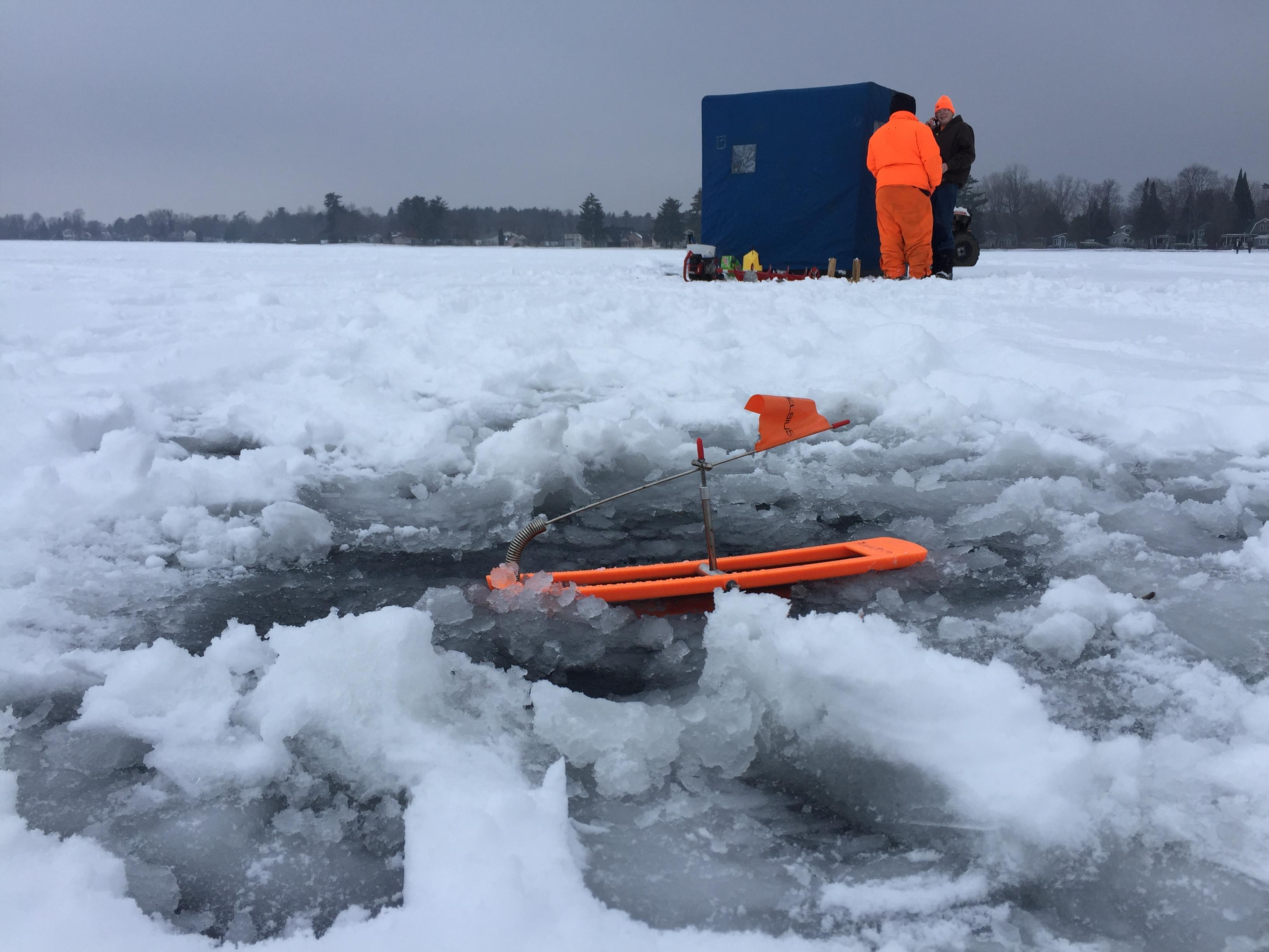 Ice fishermen Andy Wage and Tim Welch use tip ups on Shawano Lake, December 18, 2017 (WLUK/Eric Peterson)