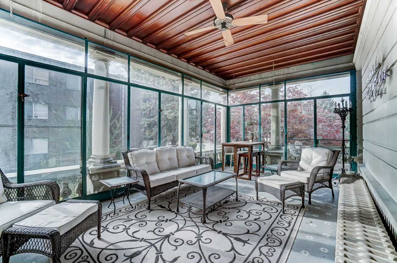One of the home's sun rooms{ }/ Image: Adam Sanregret courtesy of Coldwell Banker West Shell // Published: 4.3.20