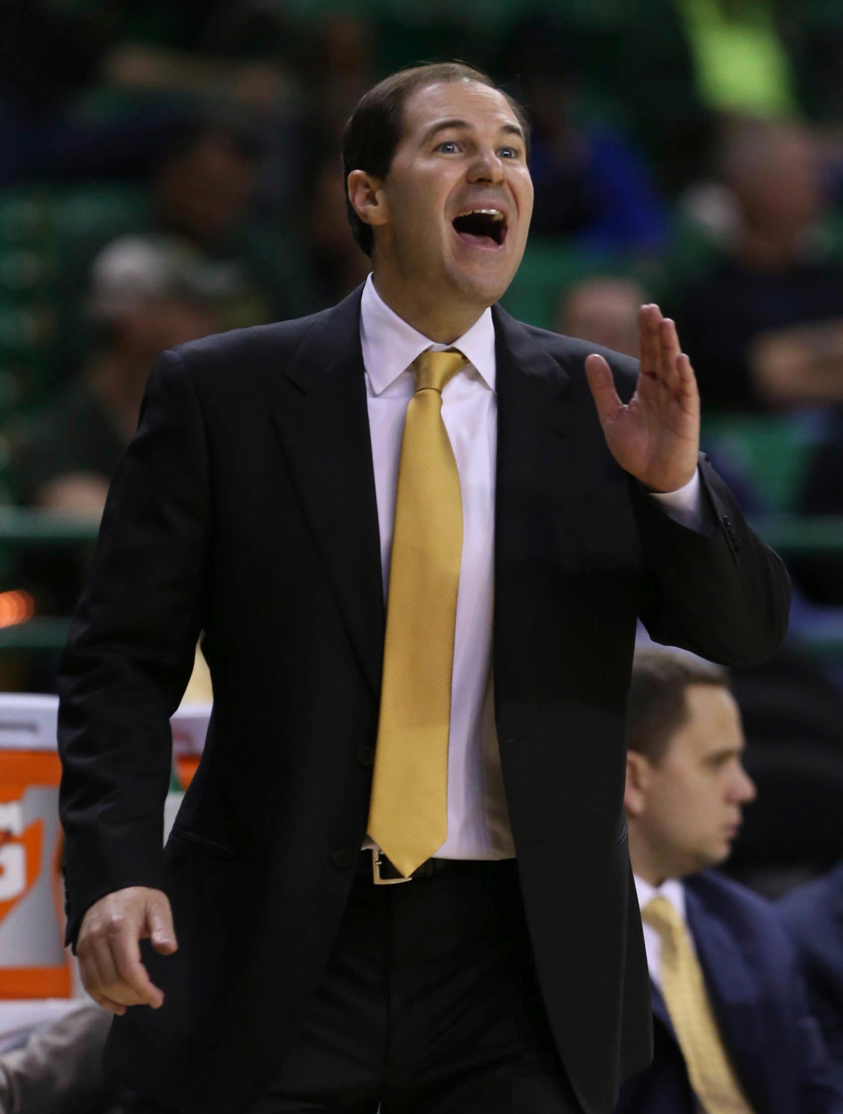Baylor head coach Scott Drew calls a play against Central Arkansas in the first half of a NCAA college basketball game, Friday, Nov. 10, 2017, in Waco, Texas. (AP Photo/Jerry Larson)
