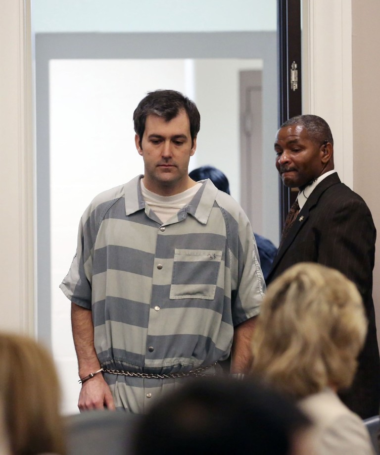 Former North Charleston police office Michael Slager, is lead into court, Thursday, Sept. 10, 2015 in Charleston, S.C. A judge reached no decision Thursday on whether to grant bail for Slager, a white former police officer charged with killing an unarmed black man following a traffic stop in coastal South Carolina. (Grace Beahm/The Post And Courier via AP){ }