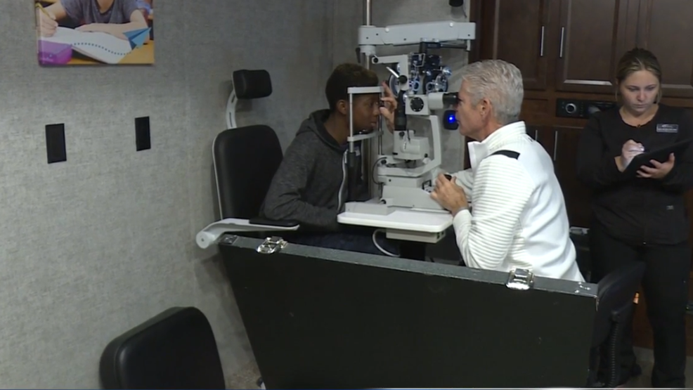 Mobile Eye Exam Unit Traveling From School To School Giving