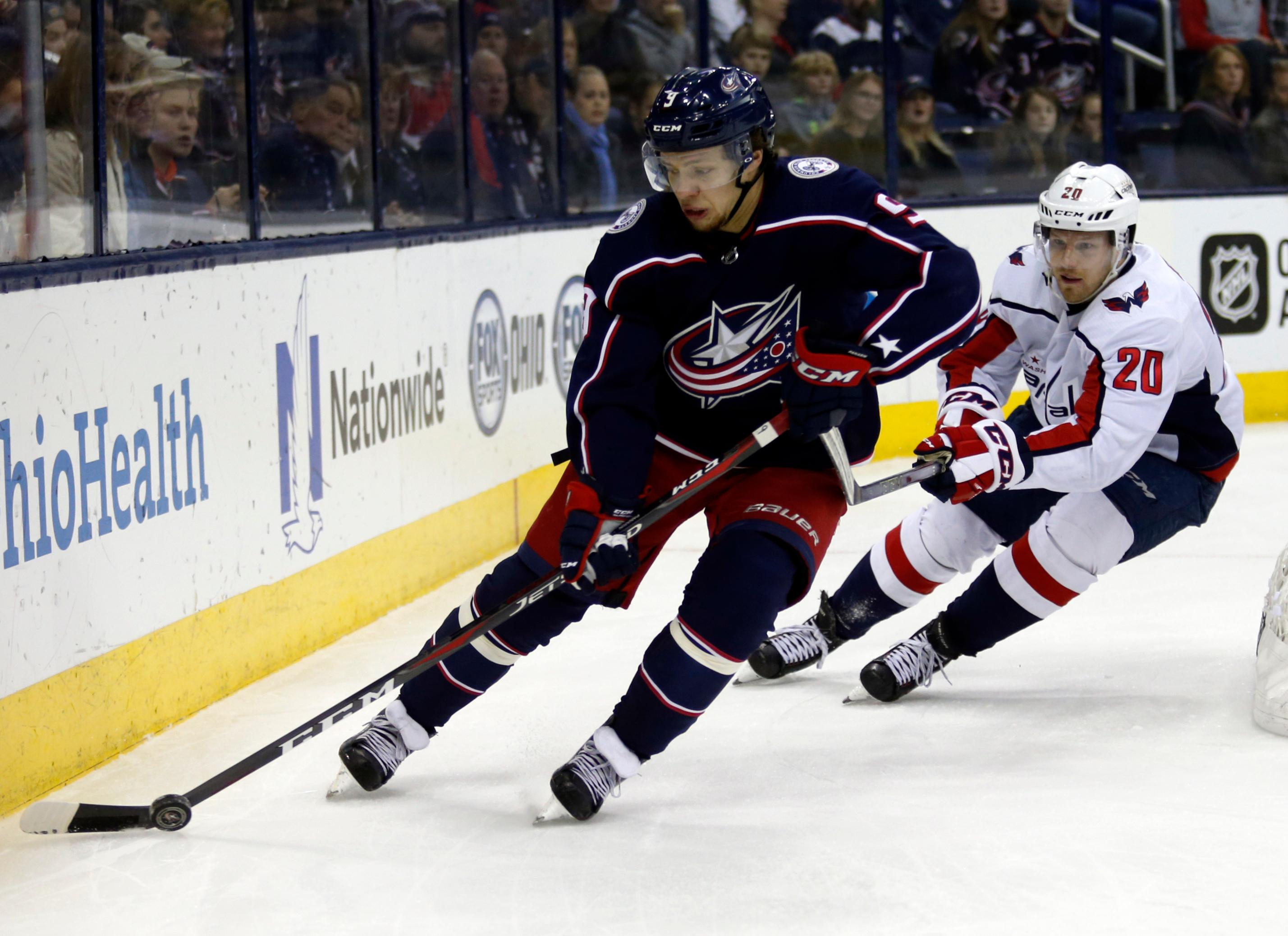 Columbus Blue Jackets forward Artemi Panarin, left, of Russia, controls the puck against Washington Capitals forward Lars Eller, of Denmark, during the first period of an NHL hockey game in Columbus, Ohio, Monday, Feb. 26, 2018. (AP Photo/Paul Vernon)