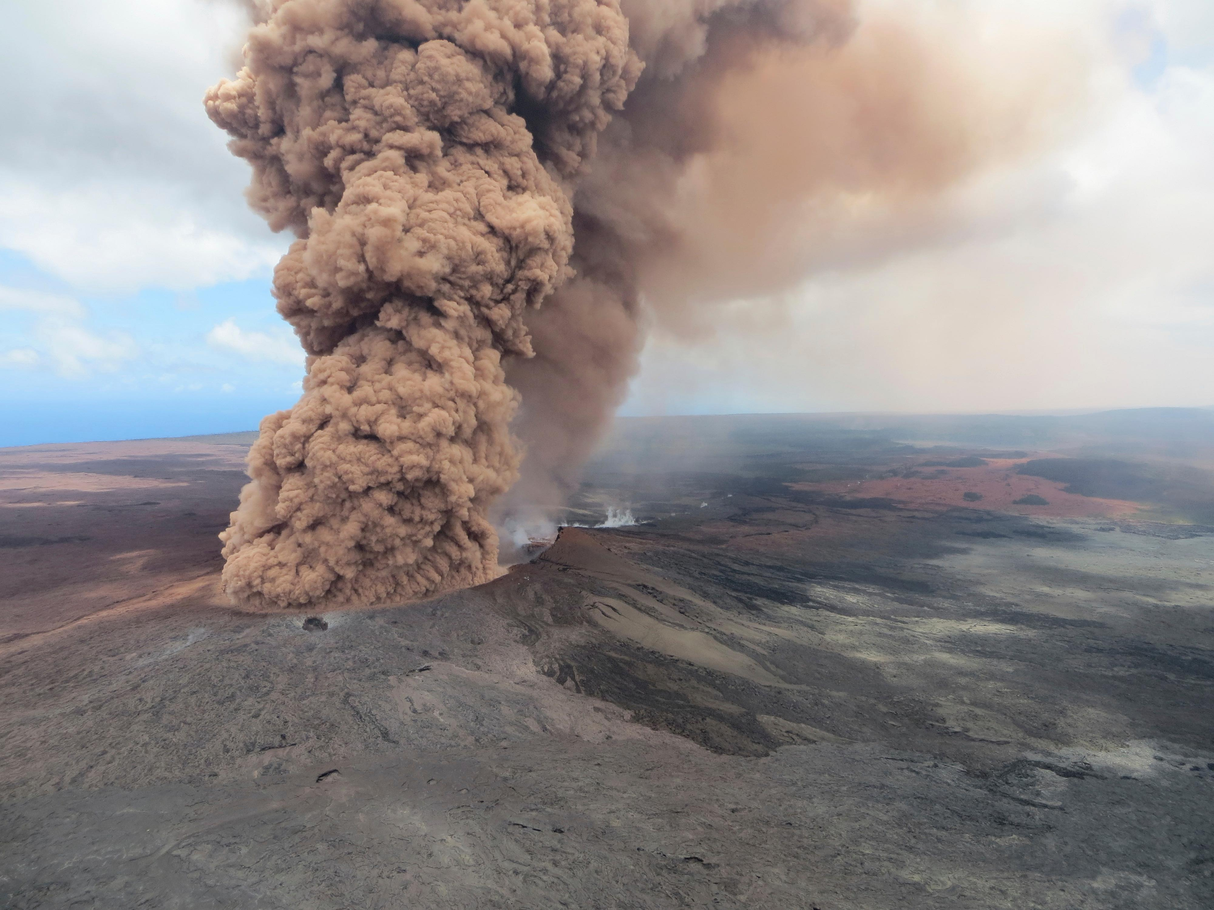 This Friday, May 4, 2018, aerial image released by the U.S. Geological Survey, at 12:46 p.m. HST, a column of robust, reddish-brown ash plume occurred after a magnitude 6.9 South Flank of K?lauea earthquake shook the Big Island of Hawaii, Hawaii. The Kilauea volcano sent more lava into Hawaii communities Friday, a day after forcing more than 1,500 people to flee from their mountainside homes, and authorities detected high levels of sulfur gas that could threaten the elderly and people with breathing problems. (U.S. Geological Survey via AP)