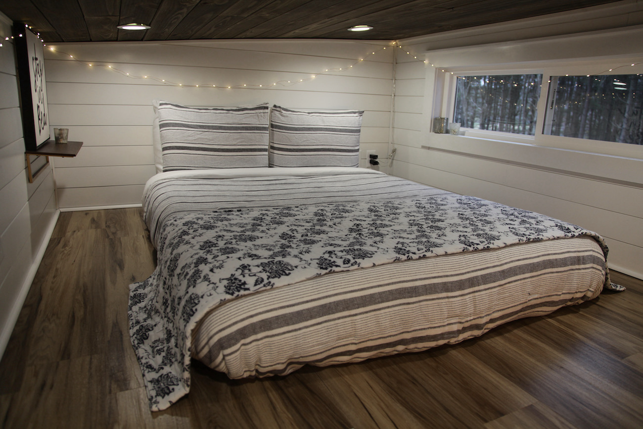 The queen bed in the cozy loft of the Trillium tiny house / Image: Chez Chesak{ }// Published: 1.24.21
