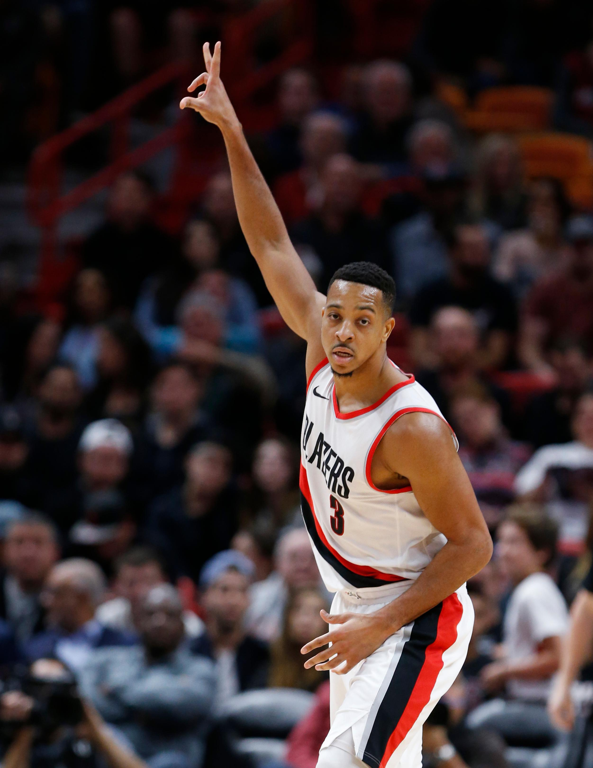Portland Trail Blazers guard C.J. McCollum celebrates after hitting a three-point shot during the first half of an NBA basketball game against the Miami Heat, Wednesday, Dec. 13, 2017, in Miami. (AP Photo/Wilfredo Lee)