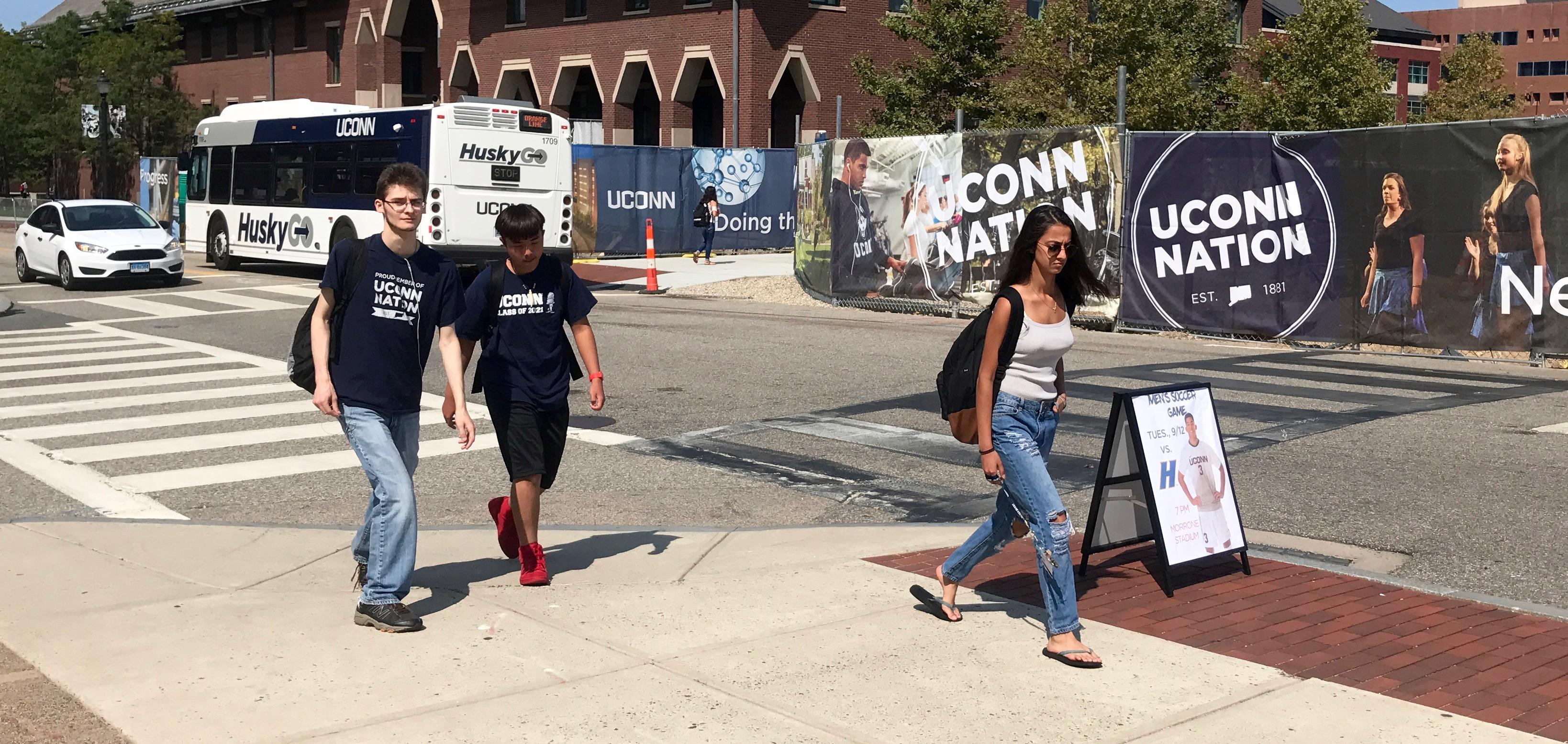 Students move between classes and construction sites at University of Connecticut. (Photo by Rick Holmes)