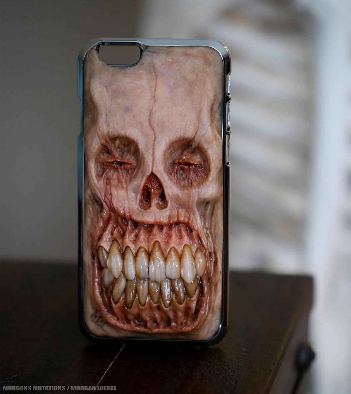 There's every chance that if you're walking down the road with this attached to your ear you're unlikely to be a victim of phone theft. Created by artist and dental tech Morgan Loebel of Kansas, these monstrous phone cases are decorated with hyper-realistic re-creations of crooked, sharp teeth human flesh, gums and terrified eyes. (WENN.com photo)