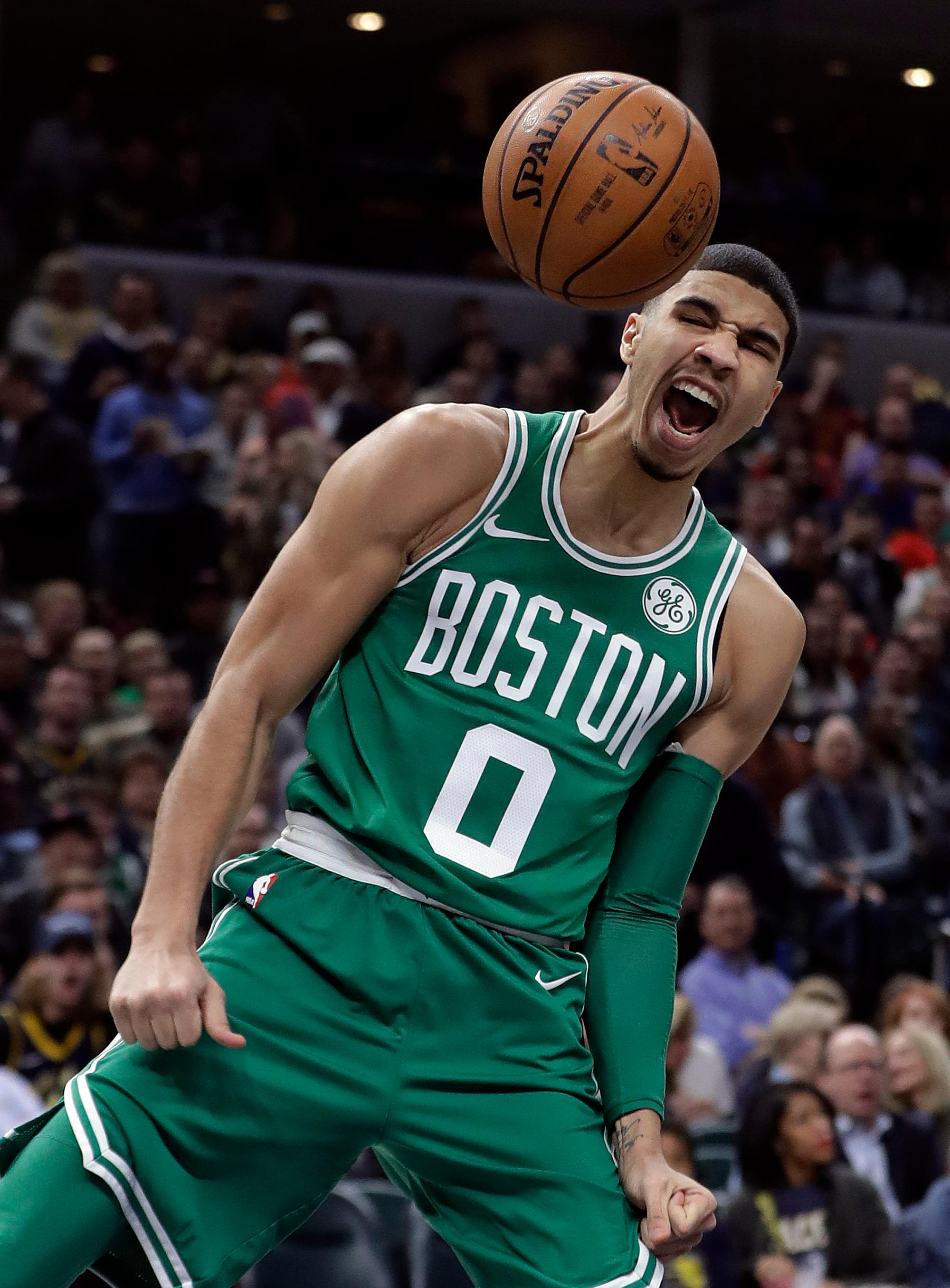 Boston Celtics' Jayson Tatum reacts after a dunk during the second half of an NBA basketball game against the Indiana Pacers, Monday, Dec. 18, 2017, in Indianapolis. (AP Photo/Darron Cummings)