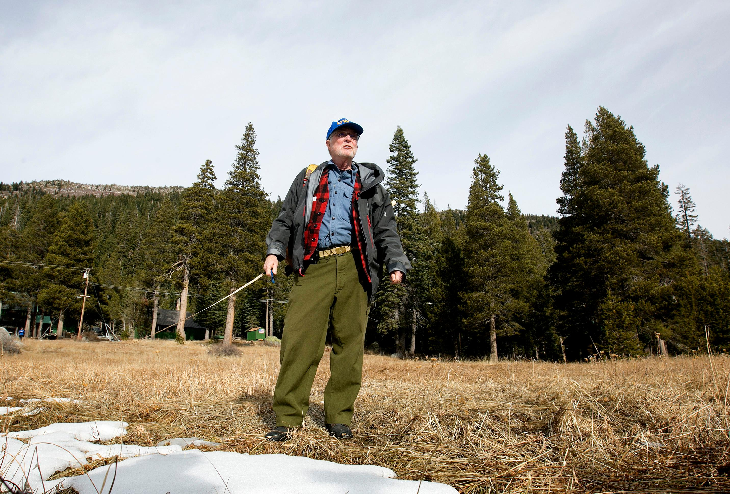 Frank Gehrke, chief of the California Cooperative Snow Surveys Program for the Department of Water Resources, looks over a nearly snow barren meadow while conducting the first snow survey of the season at the Phillips Station snow course, Wednesday, Jan. 3, 2018, near Echo Summit, Calif. (AP Photo/Rich Pedroncelli)