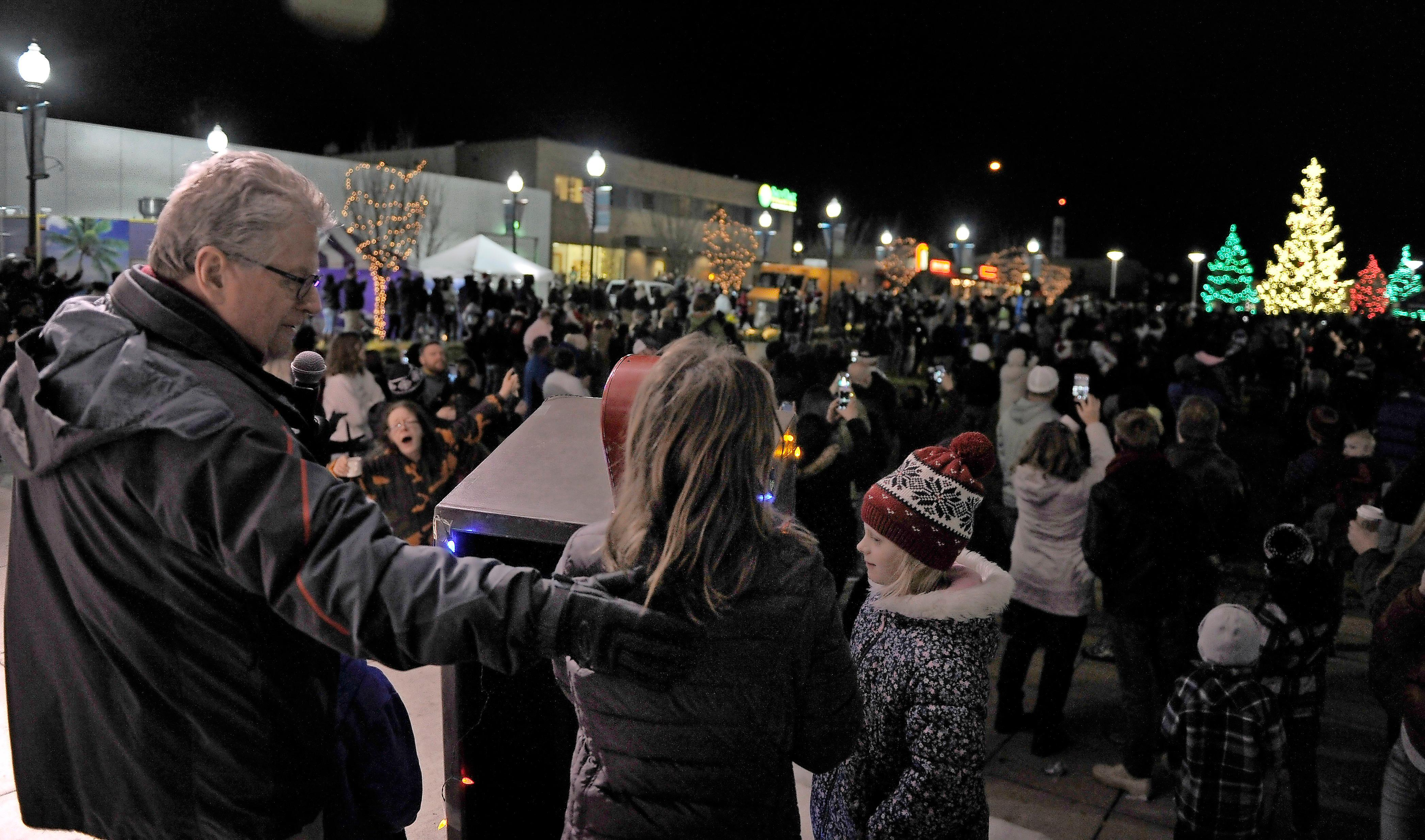 Andy Atkinson / Mail TribuneMedford Mayor Gary Wheeler invited kids onto stage to illuminate the trees in Pear Blossom Park Saturday night.