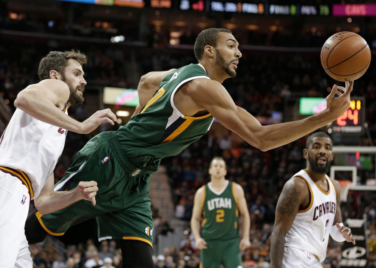 Utah Jazz' Rudy Gobert, right, grabs a rebound ahead of Cleveland Cavaliers' Kevin Love, left, in the first half of an NBA basketball game, Thursday, March 16, 2017, in Cleveland. (AP Photo/Tony Dejak)