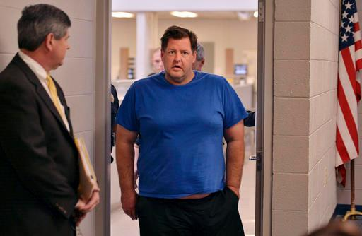Todd Kohlhepp is escorted into a Spartanburg County magistrate courtroom, Friday, Nov. 4, 2016, in Spartanburg, S.C.. Kohlhepp, a 45-year-old registered sex offender with a previous kidnapping conviction, appeared at a bond hearing Friday on a kidnapping charge in connection to a woman being found chained inside a storage container on a property in Woodruff, S.C. More charges will be filed later, the prosecutor told the court.  (Tim Kimzey/The Spartanburg Herald-Journal via AP)