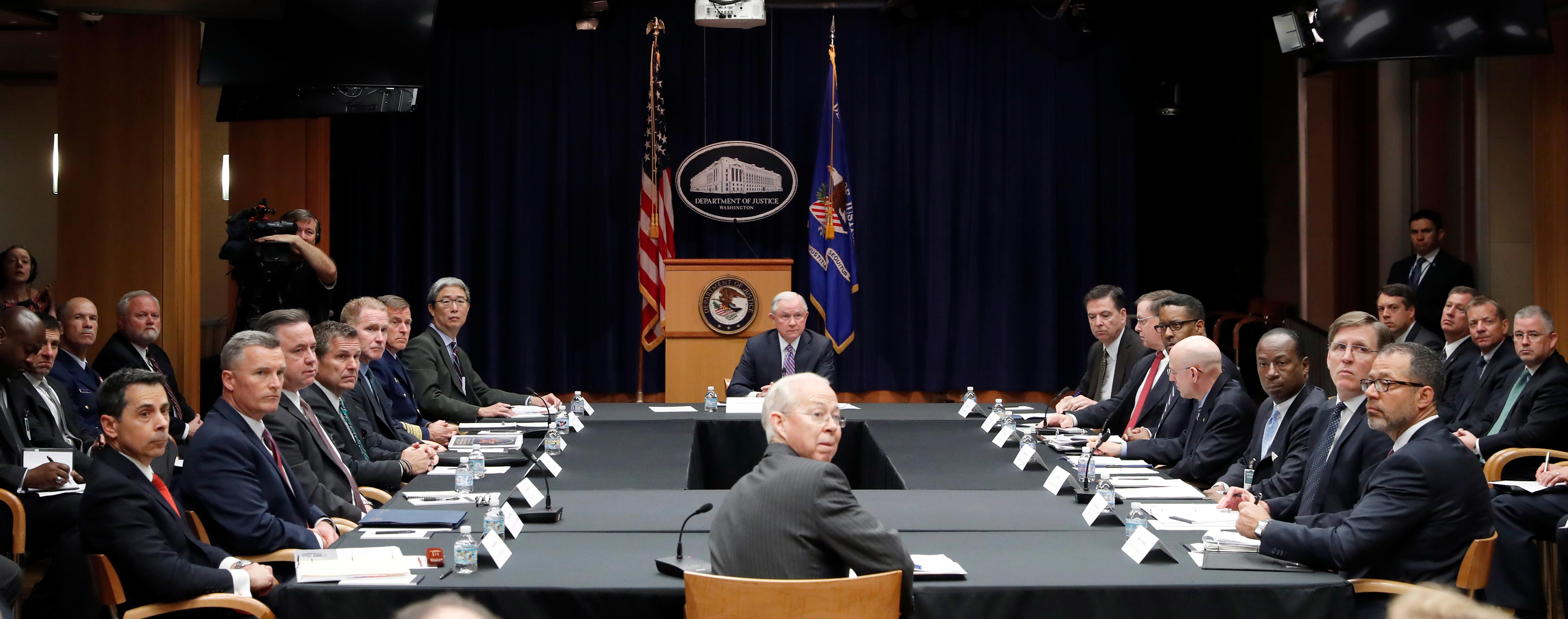 Attorney General Jeff Sessions, seated at the head of the table, listens to a reporter's question before a meeting of the Attorney General's Organized Crime Council and Organized Crime Drug Enforcement Task Forces (OCDETF) Executive Committee to discuss implementation of the President's Executive Order 13773, Tuesday, April 18, 2017, at the Justice Department in Washington. (AP Photo/Alex Brandon)