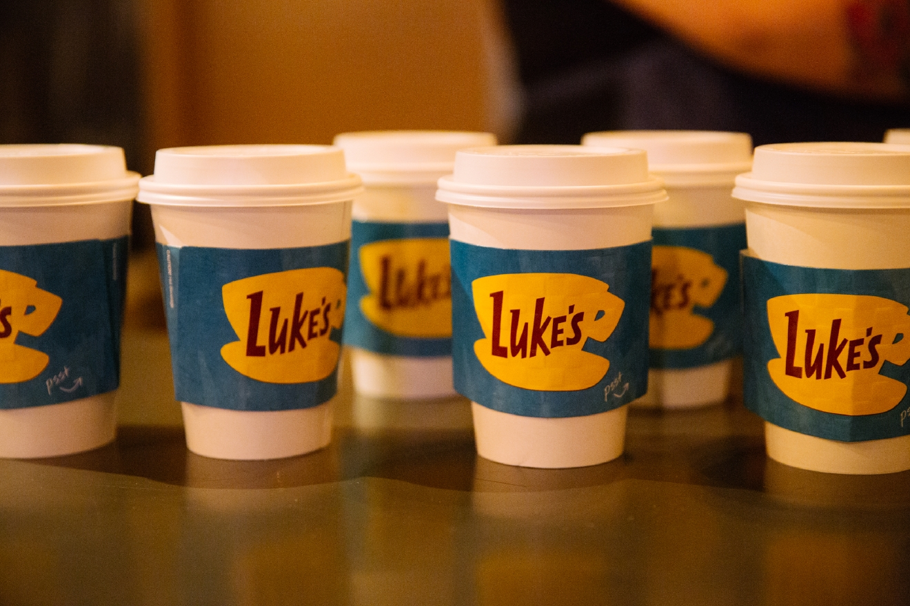 Gilmore Girls fans lined up for hours in the rain to get a cup of coffee at Luke's Diner. As part of the Gilmore Girls reboot and 16th anniversary, Netflix brought pop-up versions of Luke's Diners to Drip City Coffee in Belltown, Stone Way Cafe in Fremont and Makeda Coffee in Greenwood. (Image: Joshua Lewis / Seattle Refined)