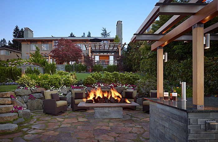This Lakefront Splendor Mercer Island project was completed by Gelotte Hommas and cost $2 million. It was 4,500 square feet originally, and 5,140 after (without increasing the footprint). They added a guest house over the garage, and outdoor living/entertaining spaces like bars, barbecues and fire tables.   (Image: Lakefront Splendor / Porch.com)