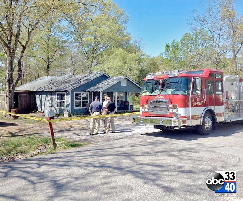 Firefighters at the scene of a fatal house fire in Etowah County, Wednesday, April 16, 2014.