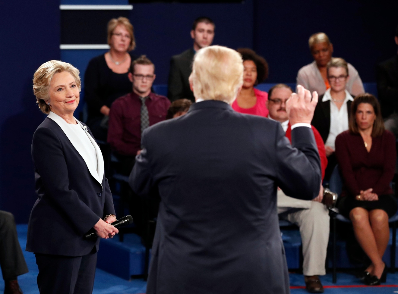 Democratic presidential nominee Hillary Clinton listens to Republican presidential nominee Donald Trump during the second presidential debate at Washington University in St. Louis, Sunday, Oct. 9, 2016. (Rick T. Wilking/Pool via AP)