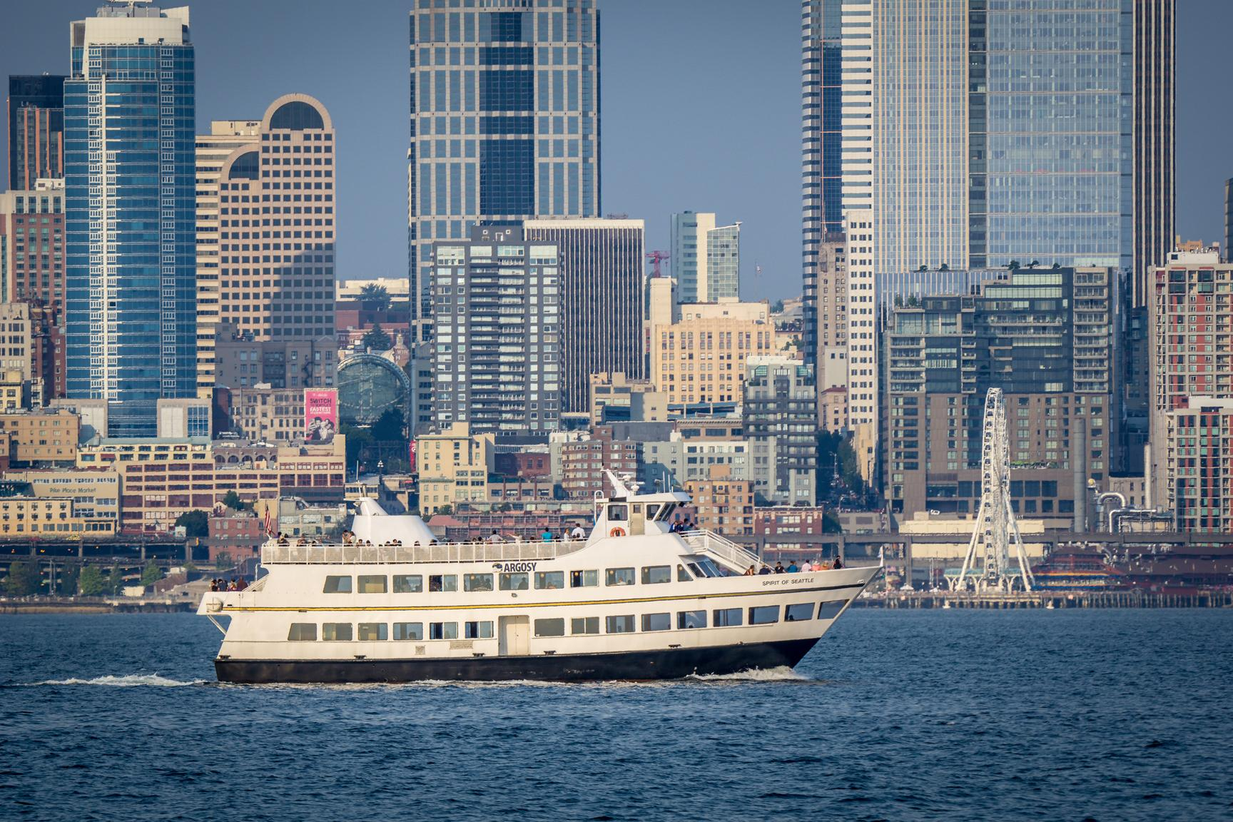 An Argosy Cruises Harbor Tour boat in Elliott Bay. (Photo courtesy of Visit Seattle/Alabastro Photography)