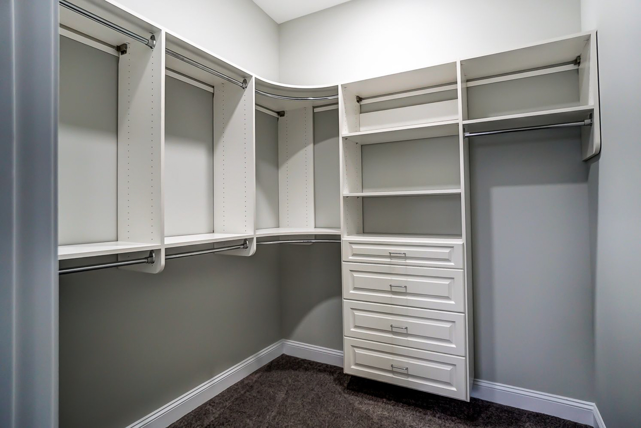 Built-in shelves and cabinetry inside the master closet / Image courtesy of Kelly Gibbs, Coldwell Banker // Published: 12.28.18