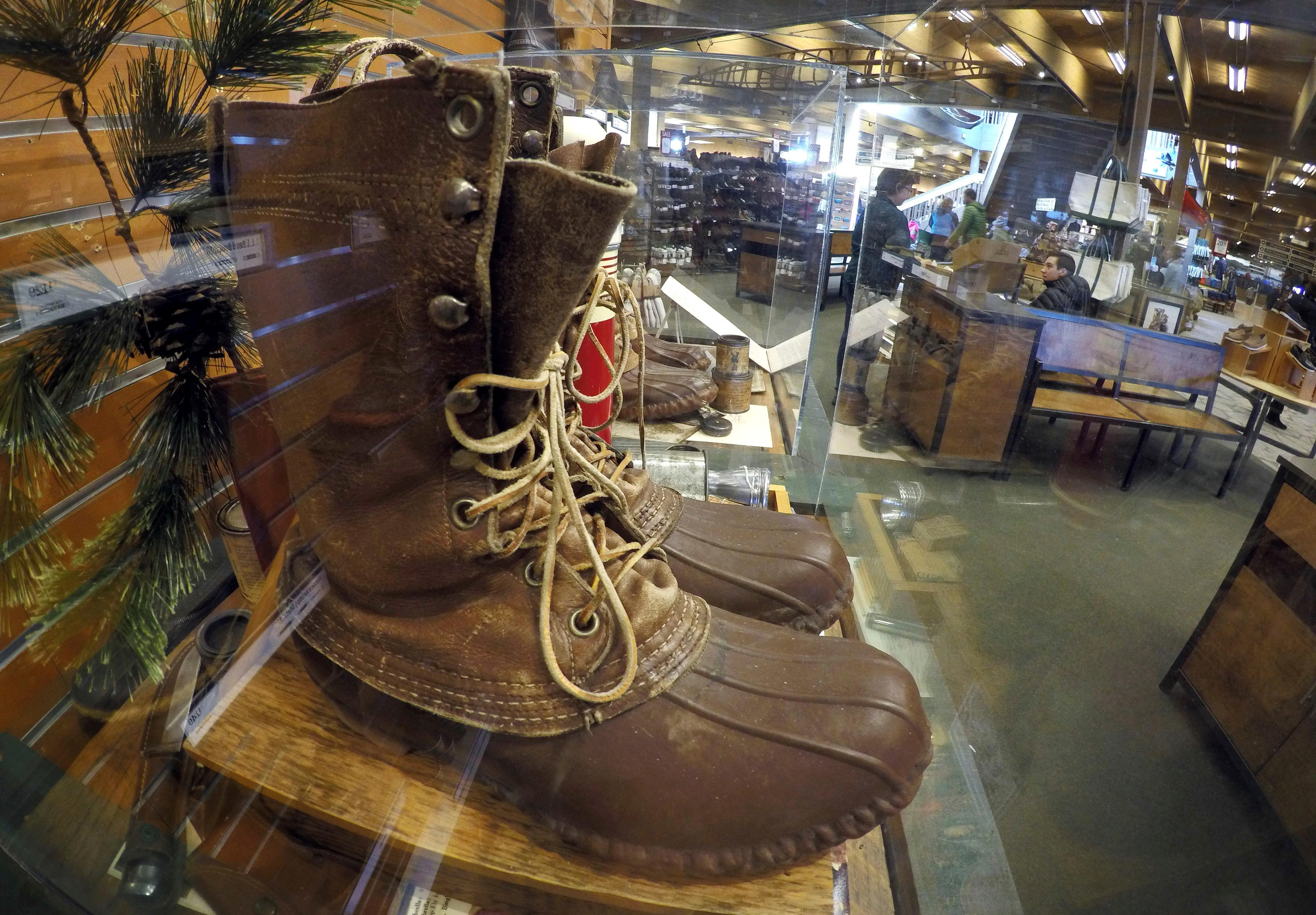 FILE - In this March 17, 2017 file photo, a early version of the Maine Hunting Shoe is displayed at the L.L. Bean flagship store in Freeport, Maine. L.L. Bean is tightening its generous return policy by imposing a one-year limit on most returns to reduce abuse and fraud. Executives say returns of severely worn items have doubled over five years. Under the new policy announced Friday, Feb. 9, 2018, the company will accept returns for one year with a proof of purchase and will continue to replace products for manufacturing defects beyond that. (AP Photo/Robert F. Bukaty, File)