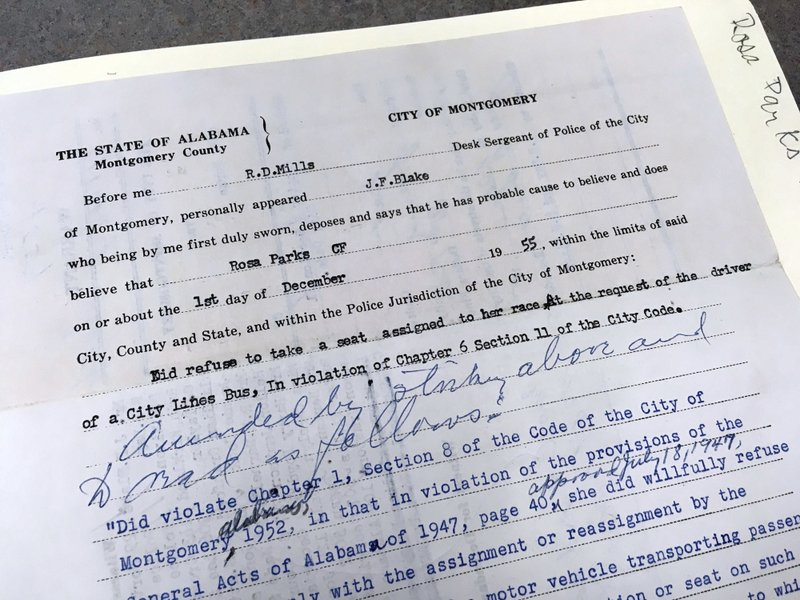 <p>A court document filed after Rosa Parks' arrest for refusing to give up her bus seat to a white man on a bus is displayed at the archive of Alabama State University in Montgomery, Ala. The university is preserving court documents linked to the civil rights era that were found in a box at the county courthouse. (Alabama State University via AP)</p>