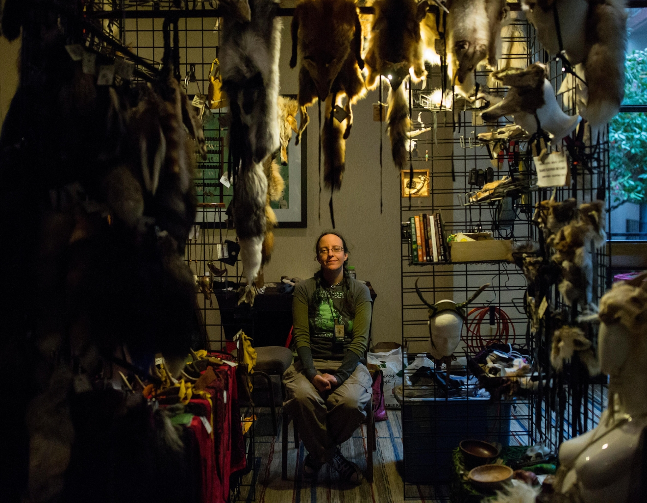Lupa, from Portland, Oregon, sits in her booth selling furs at Mythicworlds Convention and Masquerades. (Sy Bean / Seattle Refined)
