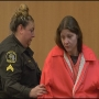Woman arraigned for mother's murder
