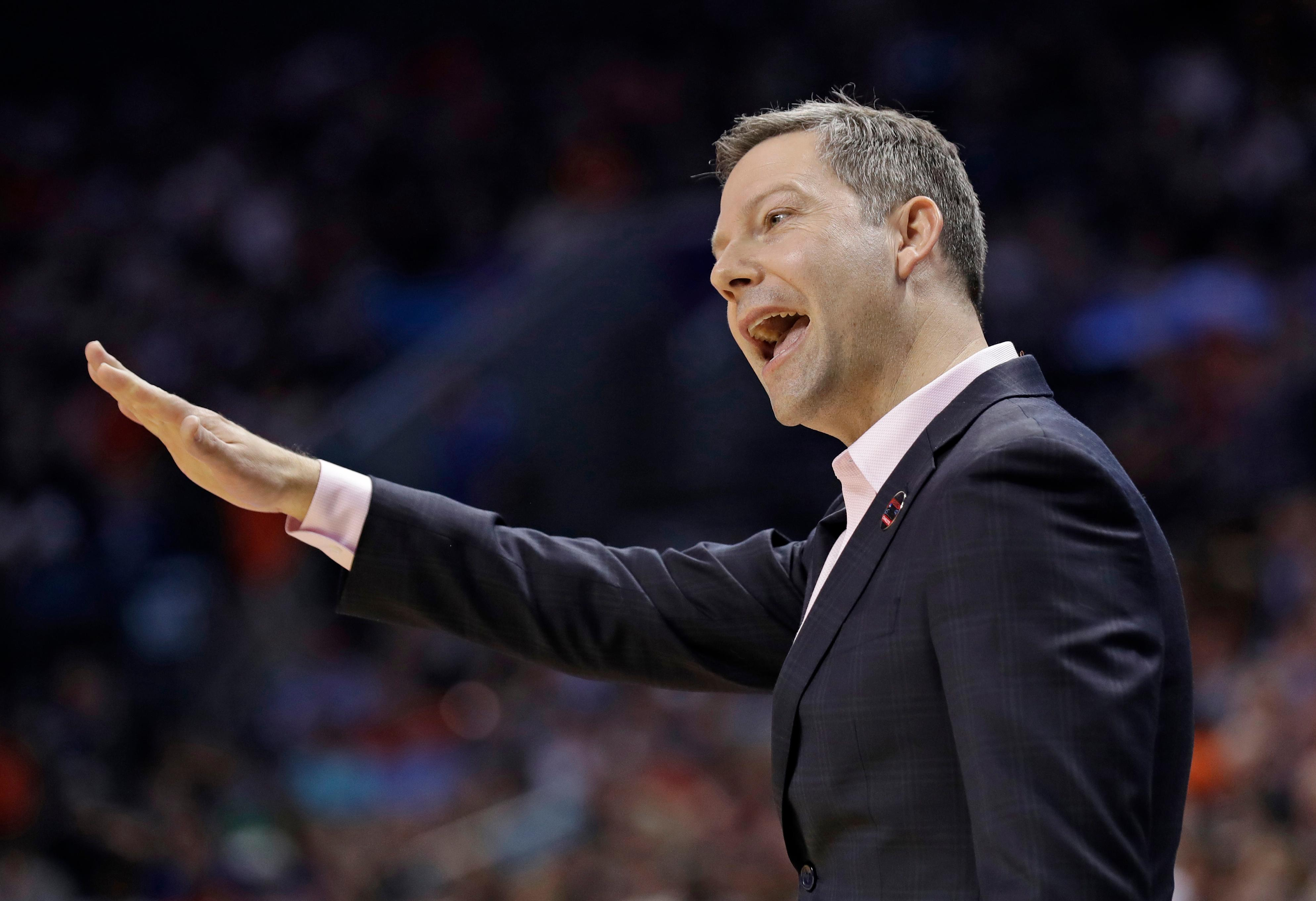 UMBC head coach Ryan Odom gestures during the first half of the team's first-round game against UMBC in the NCAA men's college basketball tournament in Charlotte, N.C., Friday, March 16, 2018. (AP Photo/Gerry Broome)