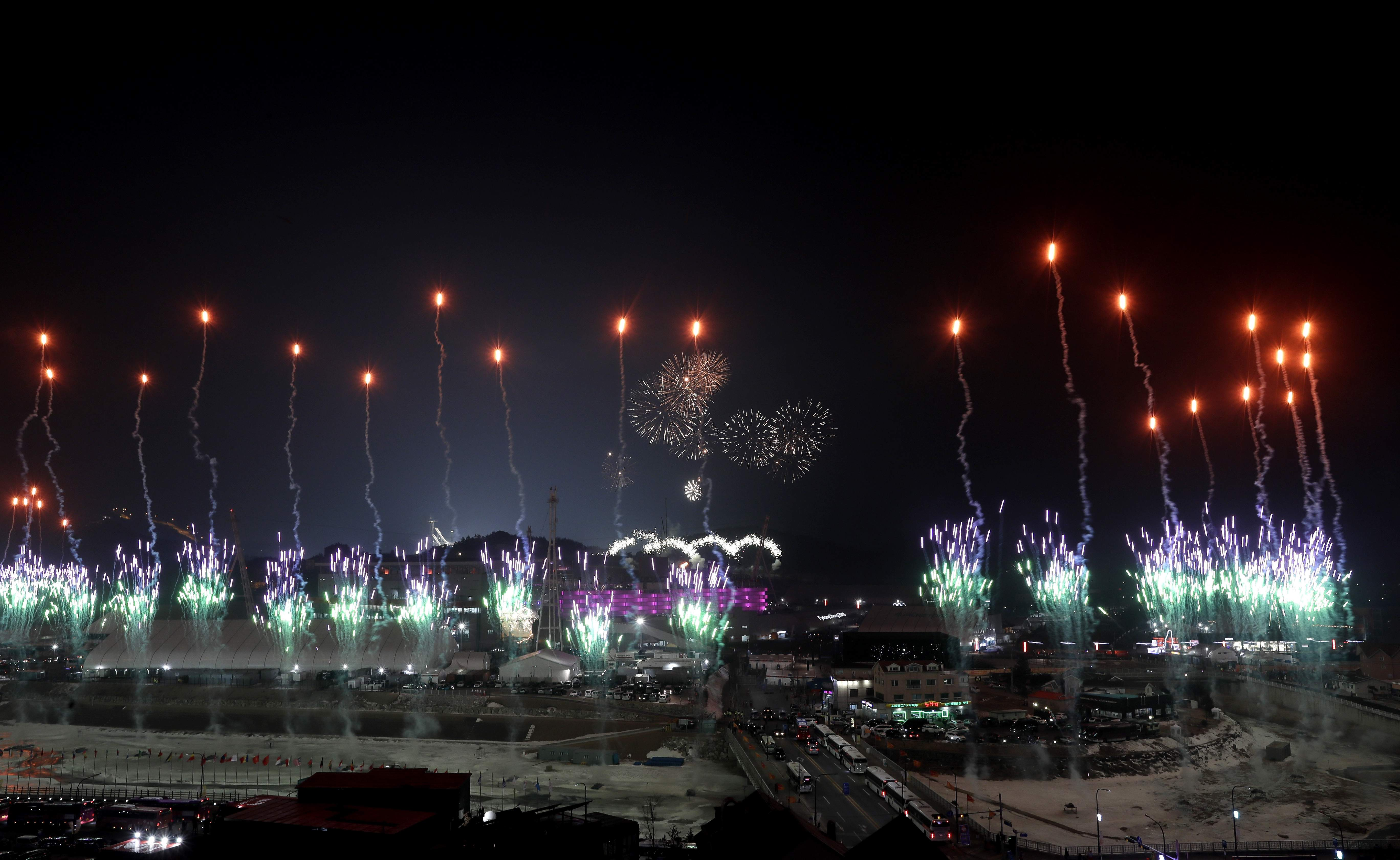 Fireworks explode around the Olympic Stadium during the opening ceremony at the 2018 Winter Olympics in Pyeongchang, South Korea, Friday, Feb. 9, 2018. (AP Photo/Kirsty Wigglesworth)