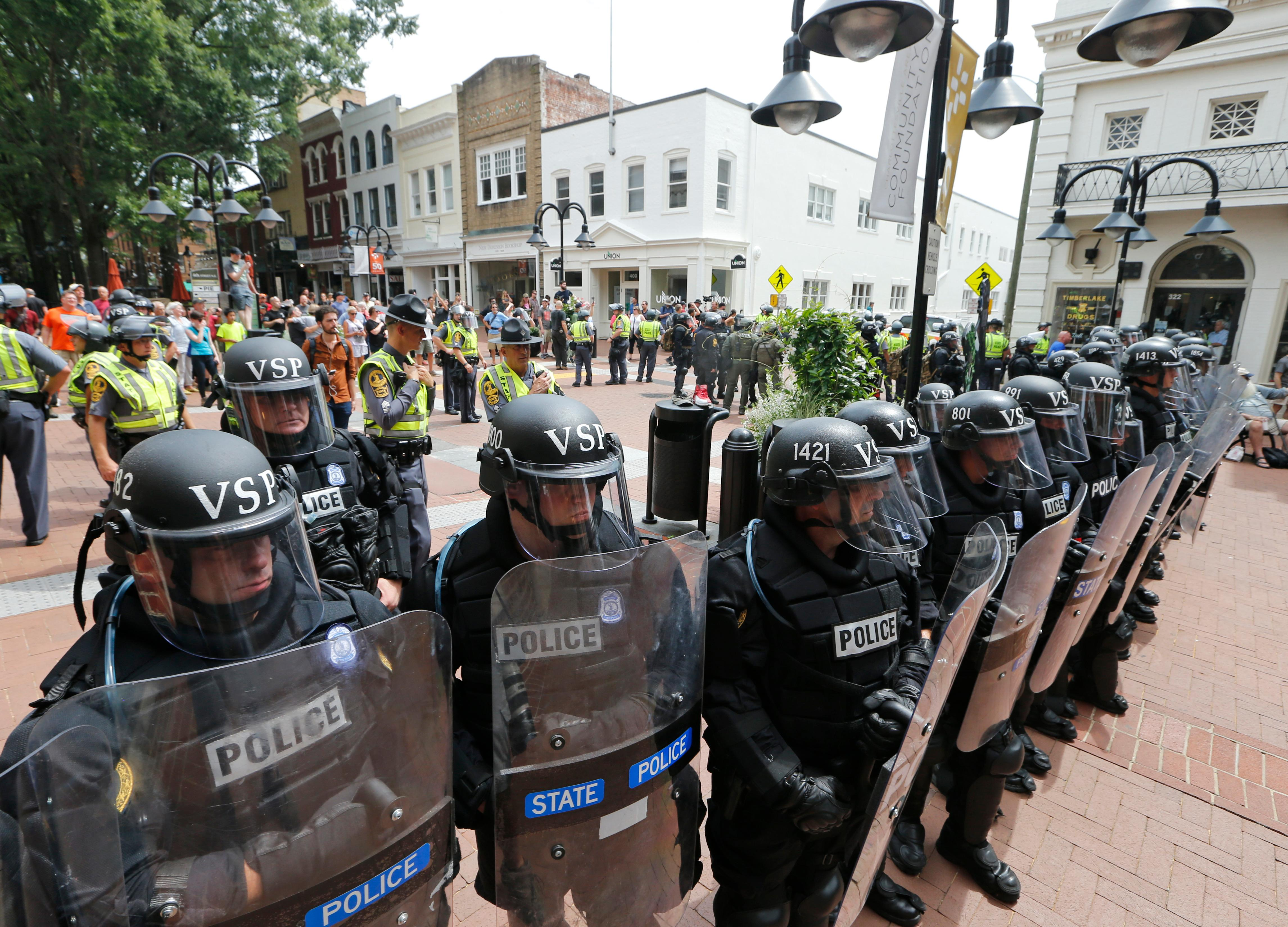 Virginia State Police cordon off an area around the site where a car ran into a group of protesters after a white nationalist rally in Charlottesville, Va., Saturday, Aug. 12, 2017. (AP Photo/Steve Helber)