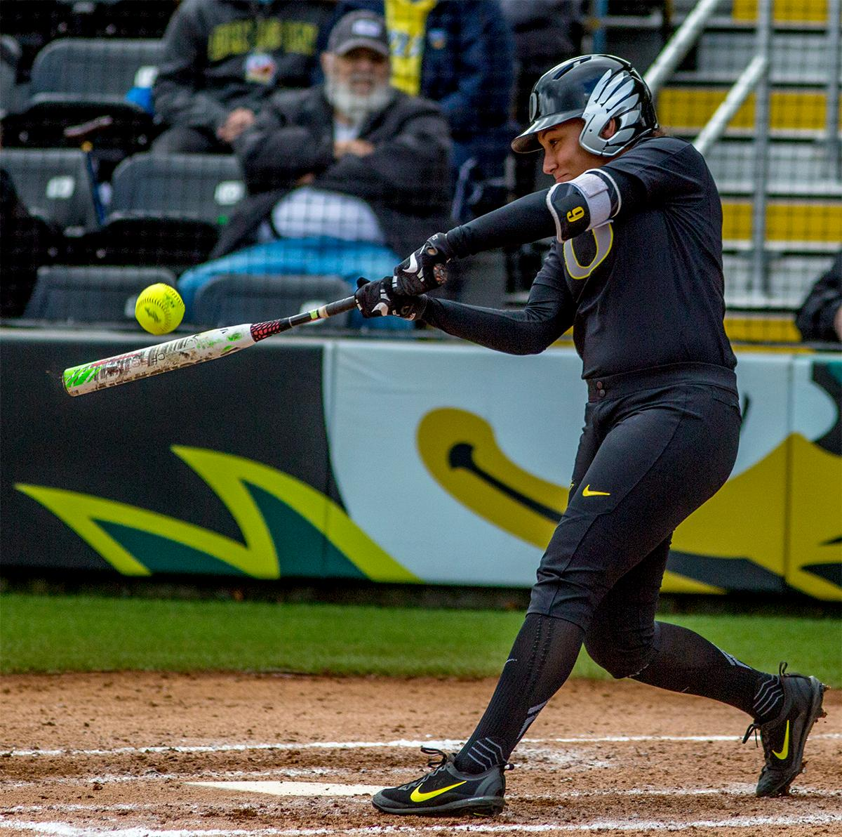 The Duck's Shannon Rhodes (#9) connects with the ball. The Oregon Ducks defeated the Cal Golden Bears 2-1 in the second game of the three game series. Photo by August Frank, Oregon News Lab