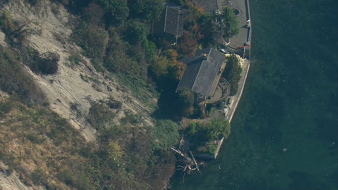The Laxdall's home was nearly wiped out by a mudslide last winter. Now, facing a $600,000 estimate to build a wall to avoid similar slides the couple say they can't afford to do anything other than sell the beloved home. (Photo: KOMO News/Air 4)